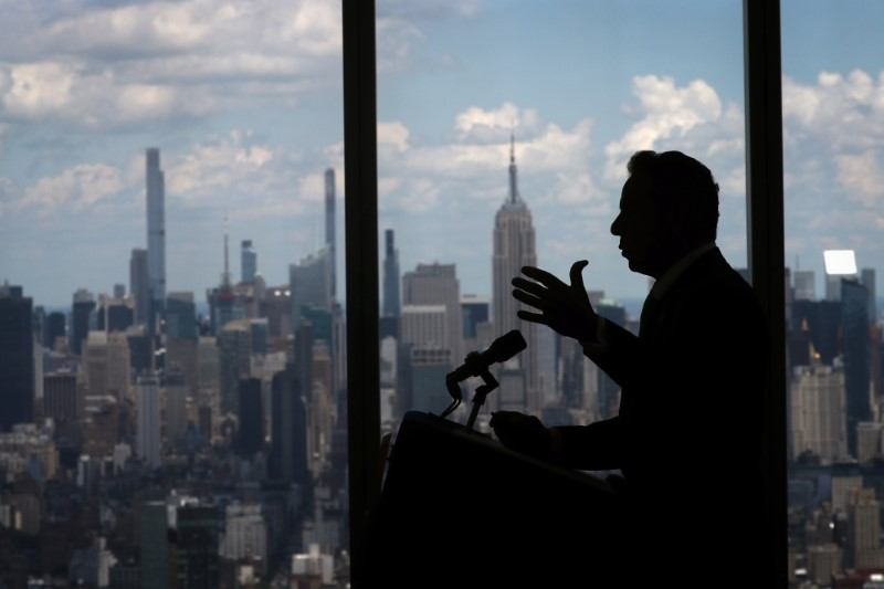 New York Governor Andrew Cuomo speaks with the skyline of Manhattan behind him from from the One World Trade Center Tower while making an announcement in New York City, New York, June 15, 2021. REUTERS/Mike Segar