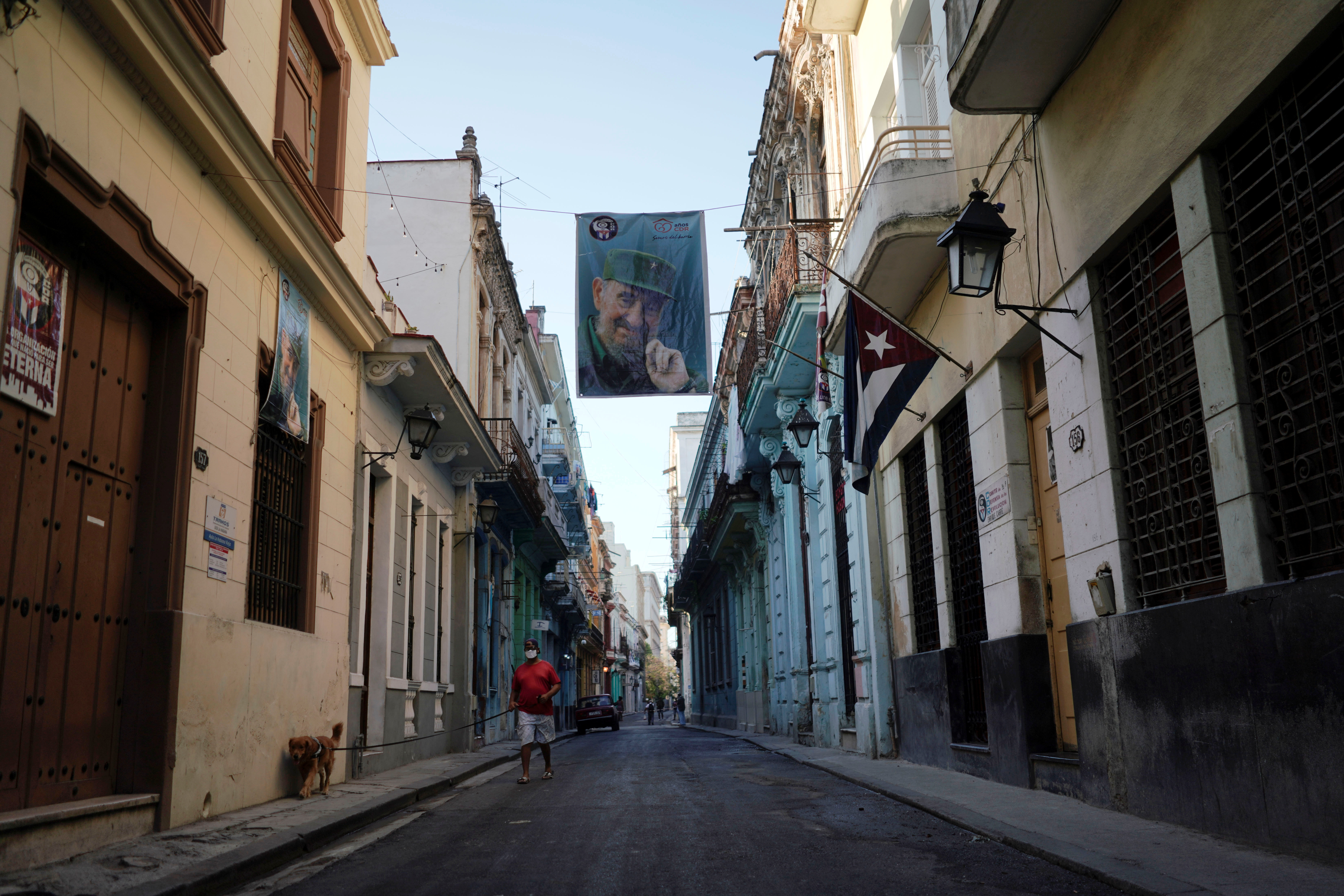 A banner displaying the portrait of late Cuban President Fidel Castro hangs on the street in downtown Havana, Cuba, May 1, 2021. REUTERS/Alexandre Meneghini