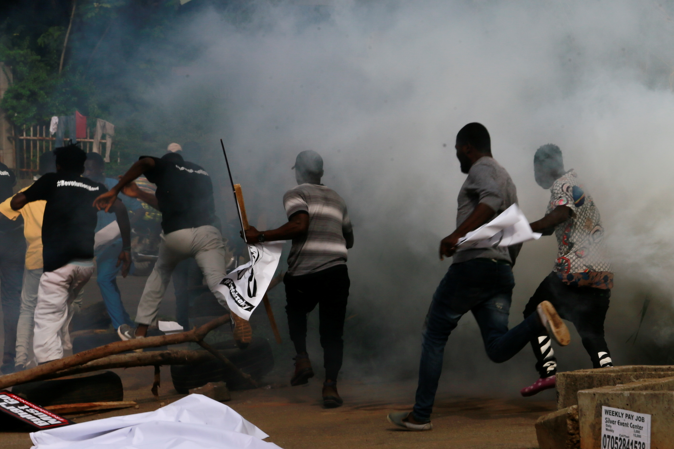 Protesters run after police fired teargas during a June 12 Democracy Day rally in Abuja, Nigeria June 12, 2021. REUTERS/Afolabi Sotunde