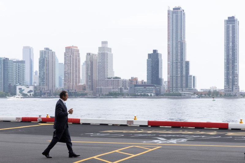 New York Governor Andrew Cuomo walks to his helicopter after announcing his resignation in Manhattan, New York City, U.S., August 10, 2021. REUTERS/Caitlin Ochs