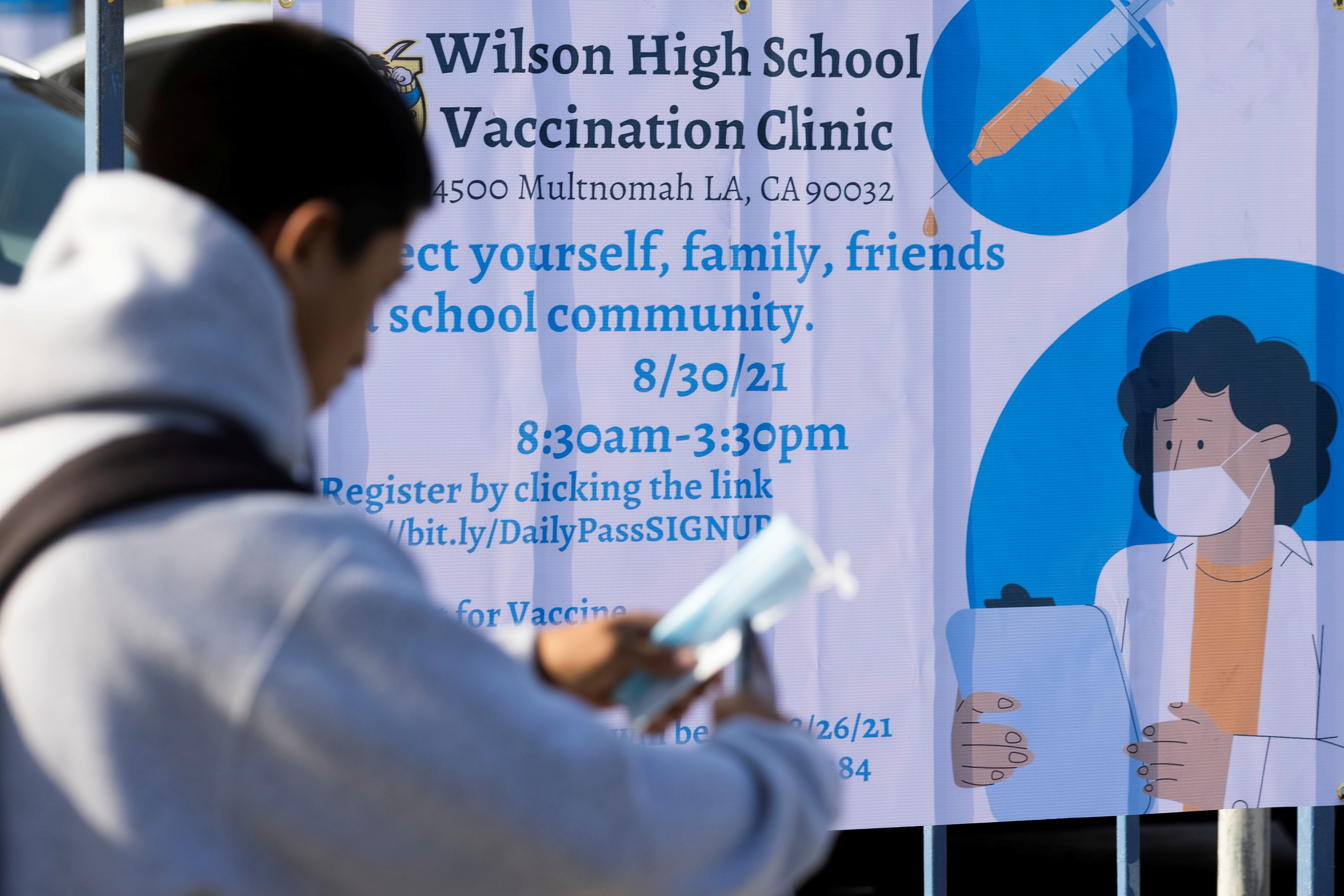 A sign is seen as a mobile vaccination teams begin visiting every Los Angeles Unified middle and high school campus to deliver first and second doses of the coronavirus disease (COVID-19) vaccines as students return to in-person classes in Los Angeles, California, U.S., August 30, 2021. REUTERS/Mike Blake