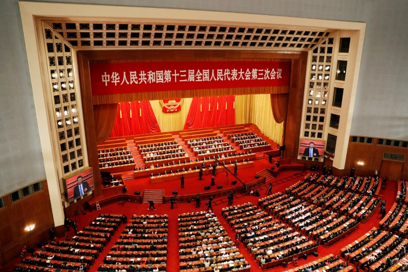 Chinese officials and delegates attend the closing session of the National People's Congress (NPC) at the Great Hall of the People in Beijing, China May 28, 2020. REUTERS/Carlos Garcia Rawlins