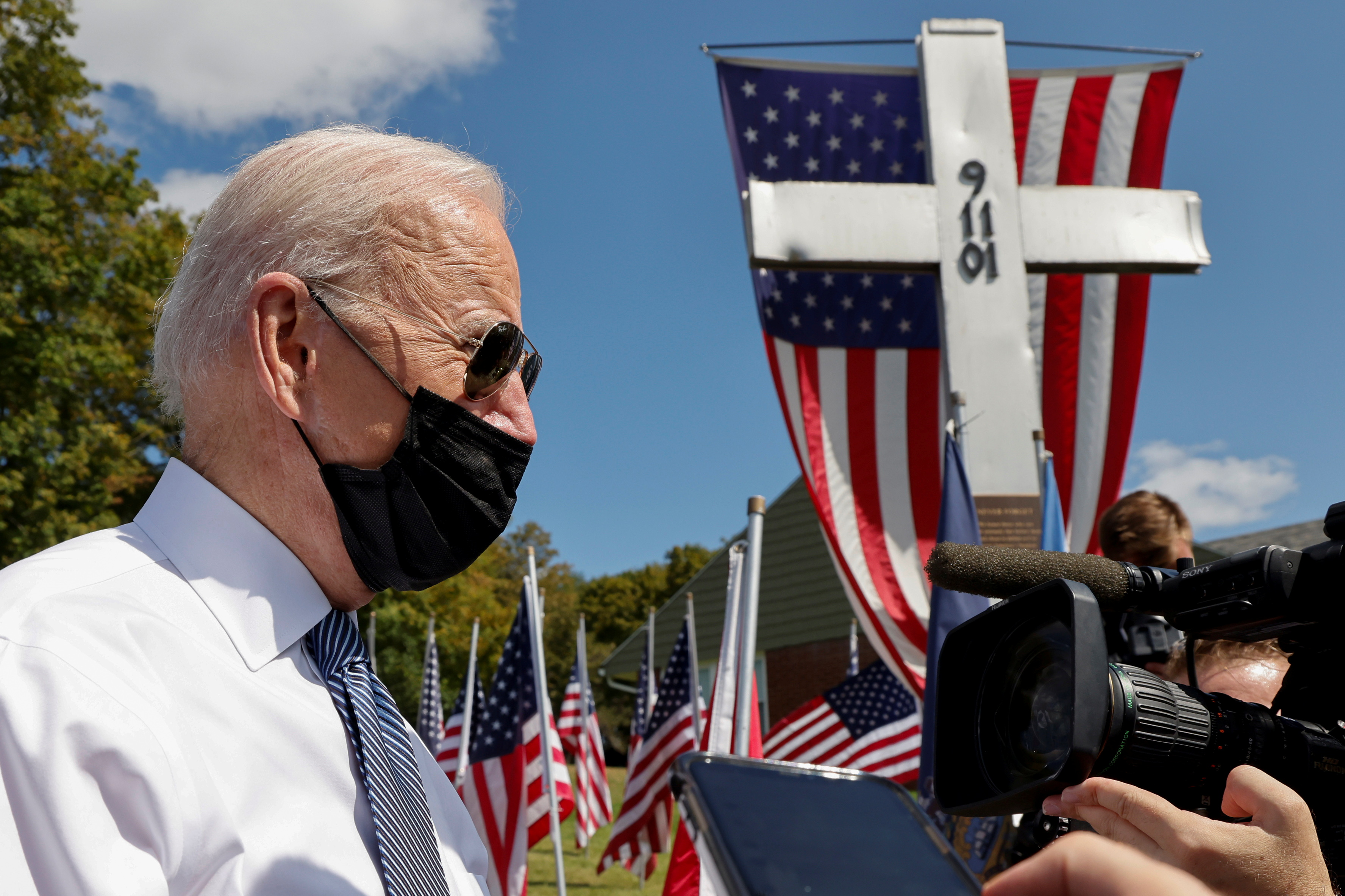 U.S. President Joe Biden speaks to reporters before paying his respects at a 9/11 memorial outside the Shanksville volunteer fire station, as he and first lady Jill Biden stopped at the fire hall after visiting the nearby site where the hijacked United Airlines Flight 93 plane crashed, on the 20th anniversary of the September 11, 2001 attacks, in Shanksville, Pennsylvania, U.S., September 11, 2021.  REUTERS/Jonathan Ernst