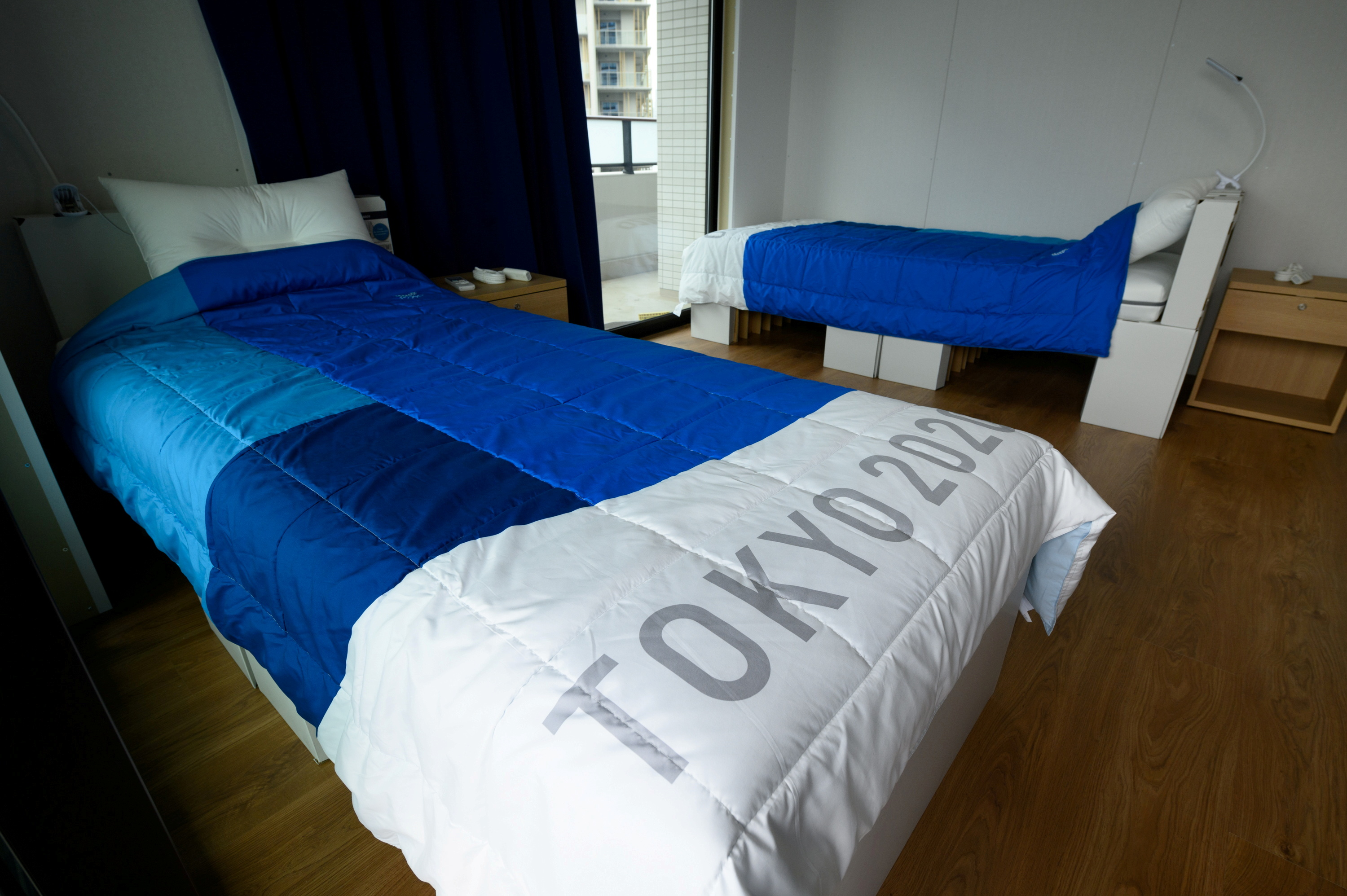 Recyclable cardboard beds and mattresses for athletes are pictured during a media tour at the Olympic and Paralympic Village for the Tokyo 2020 Games, in Tokyo, Japan June 20, 2021. Akio Kon/Pool via REUTERS/File Photo