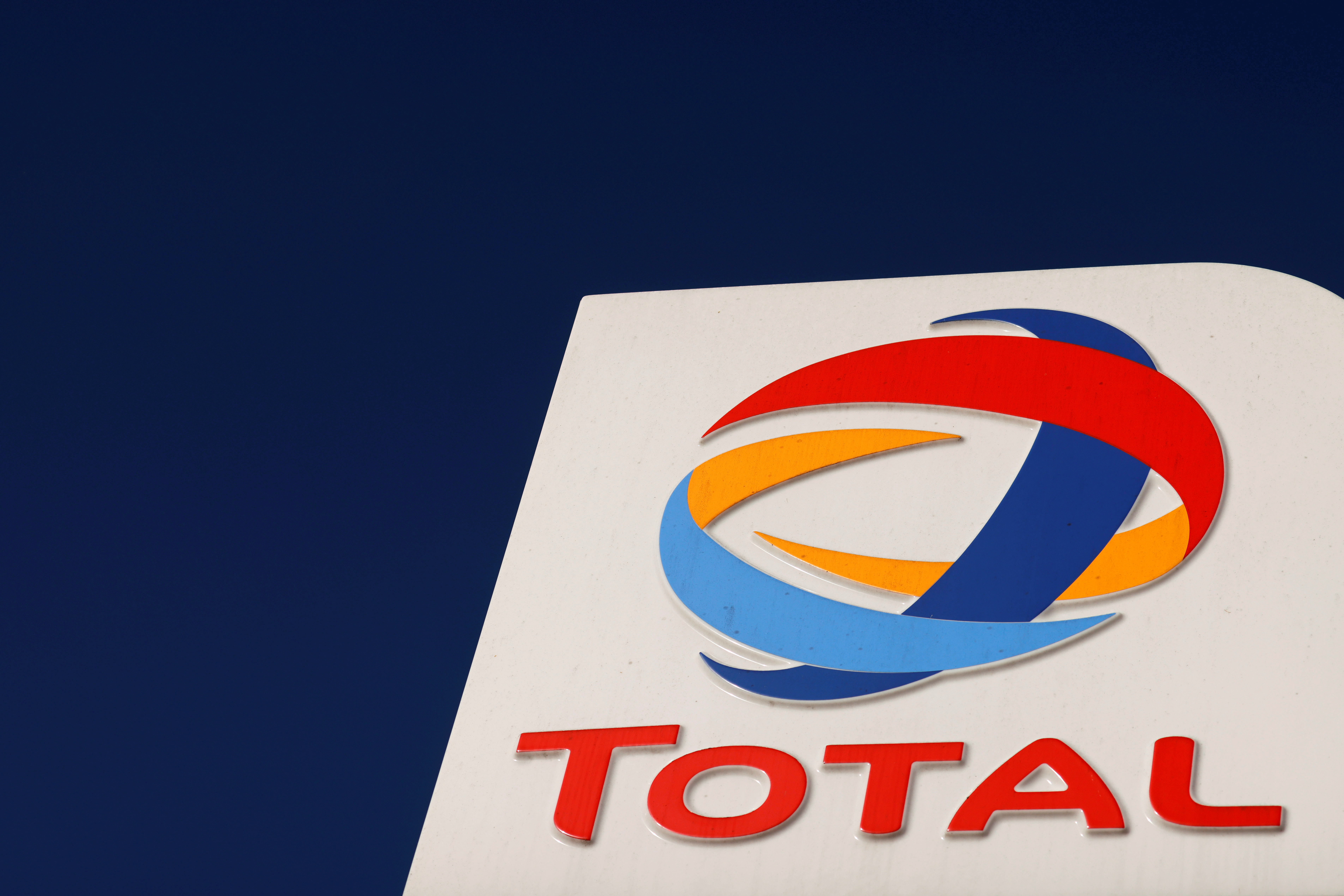 The logo of French oil and gas company Total is seen at a petrol station in Neuville Saint Remy, France, October 1, 2020. REUTERS/Pascal Rossignol/File Photo