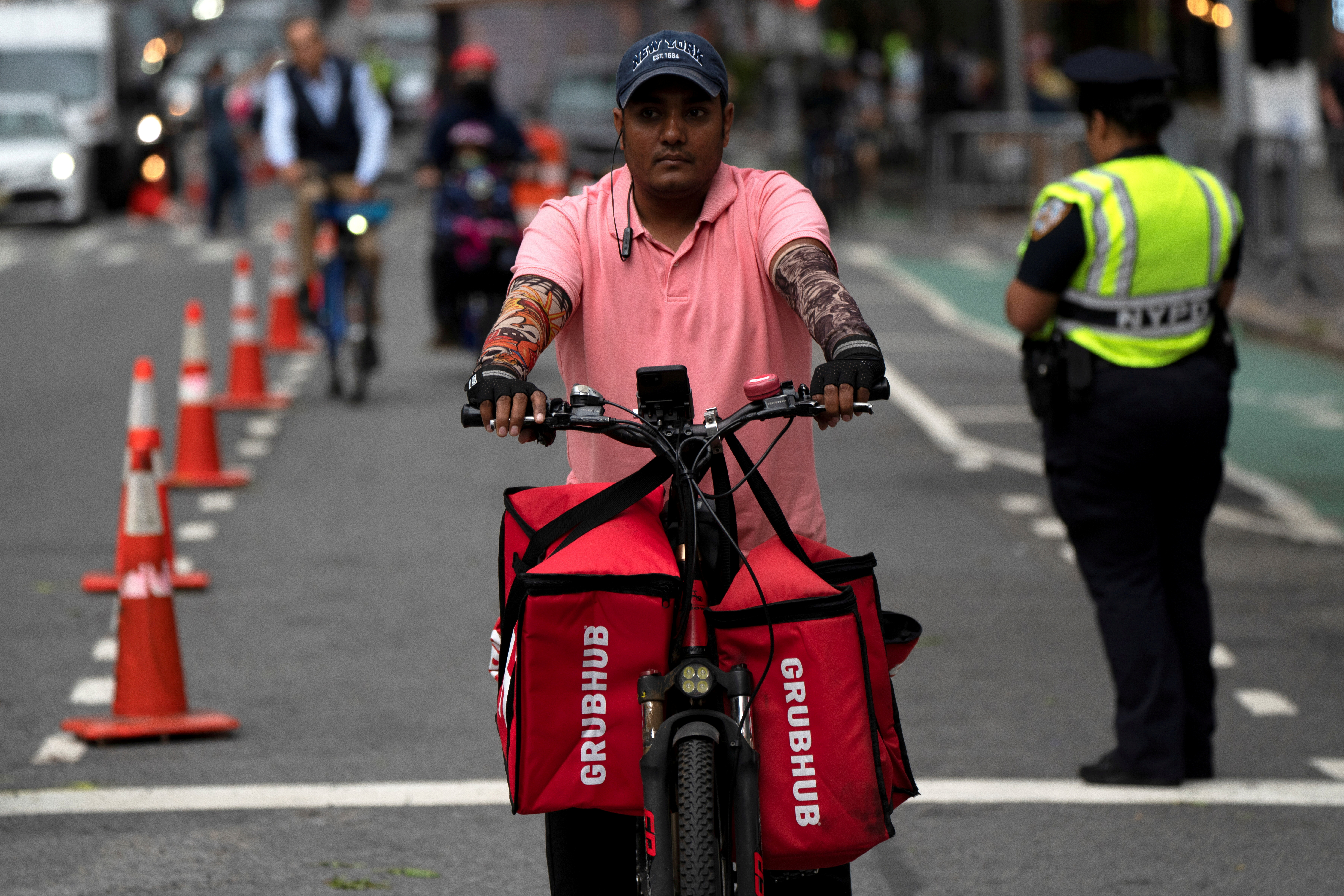 A delivery worker is pictured on the street in New York City, New York, U.S., September 23, 2021.  REUTERS/David 'Dee' Delgado/File Photo