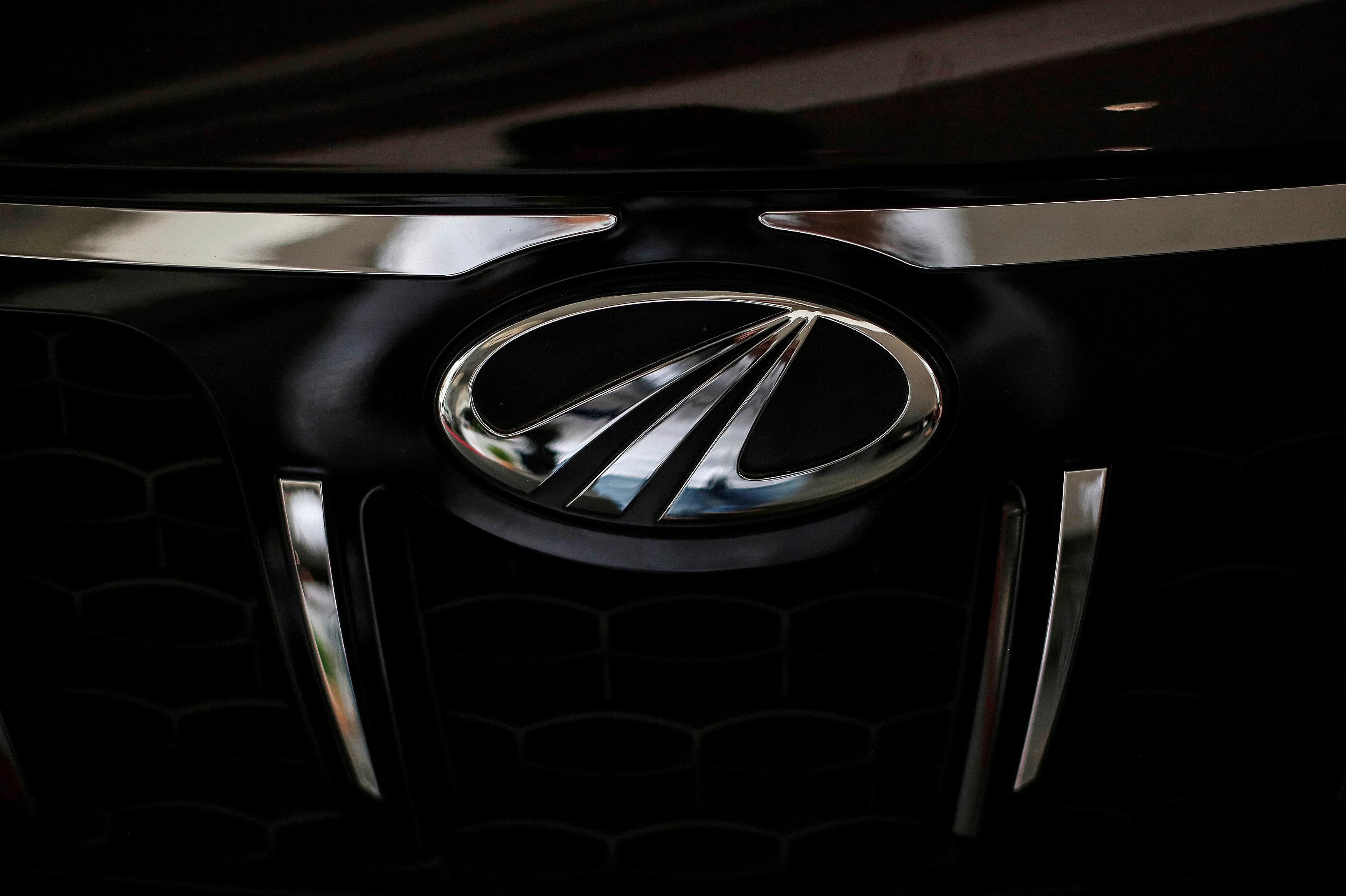 The logo of Mahindra and Mahindra is seen on a car at a showroom in Mumbai, India, August 30, 2016.  REUTERS/Danish Siddiqui