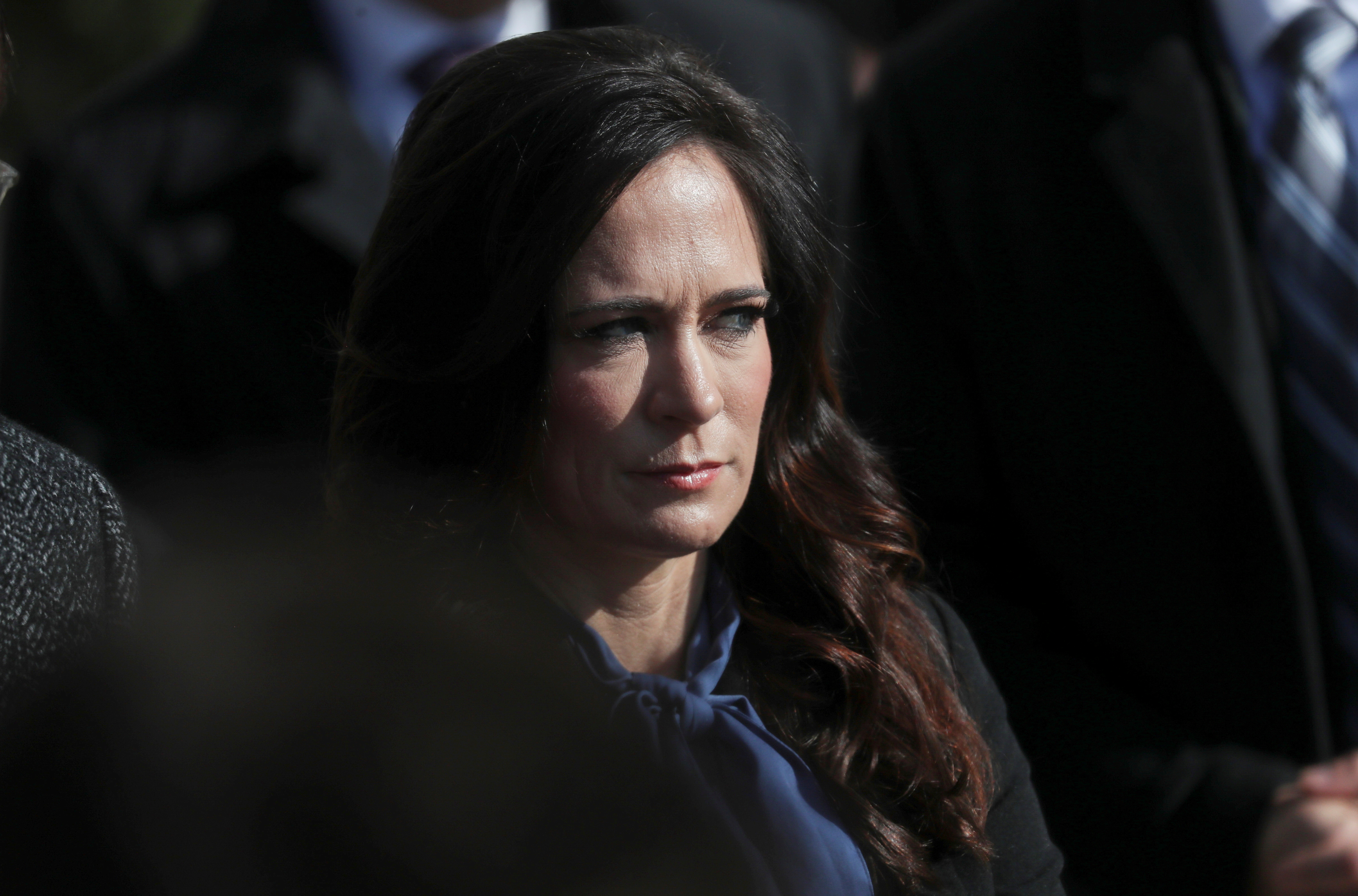 White House Press Secretary Stephanie Grisham listens to U.S. President Donald Trump talk to reporters as he departs for travel to Georgia from the South Lawn of the White House in Washington, U.S., November 8, 2019. REUTERS/Leah Millis/File Photo