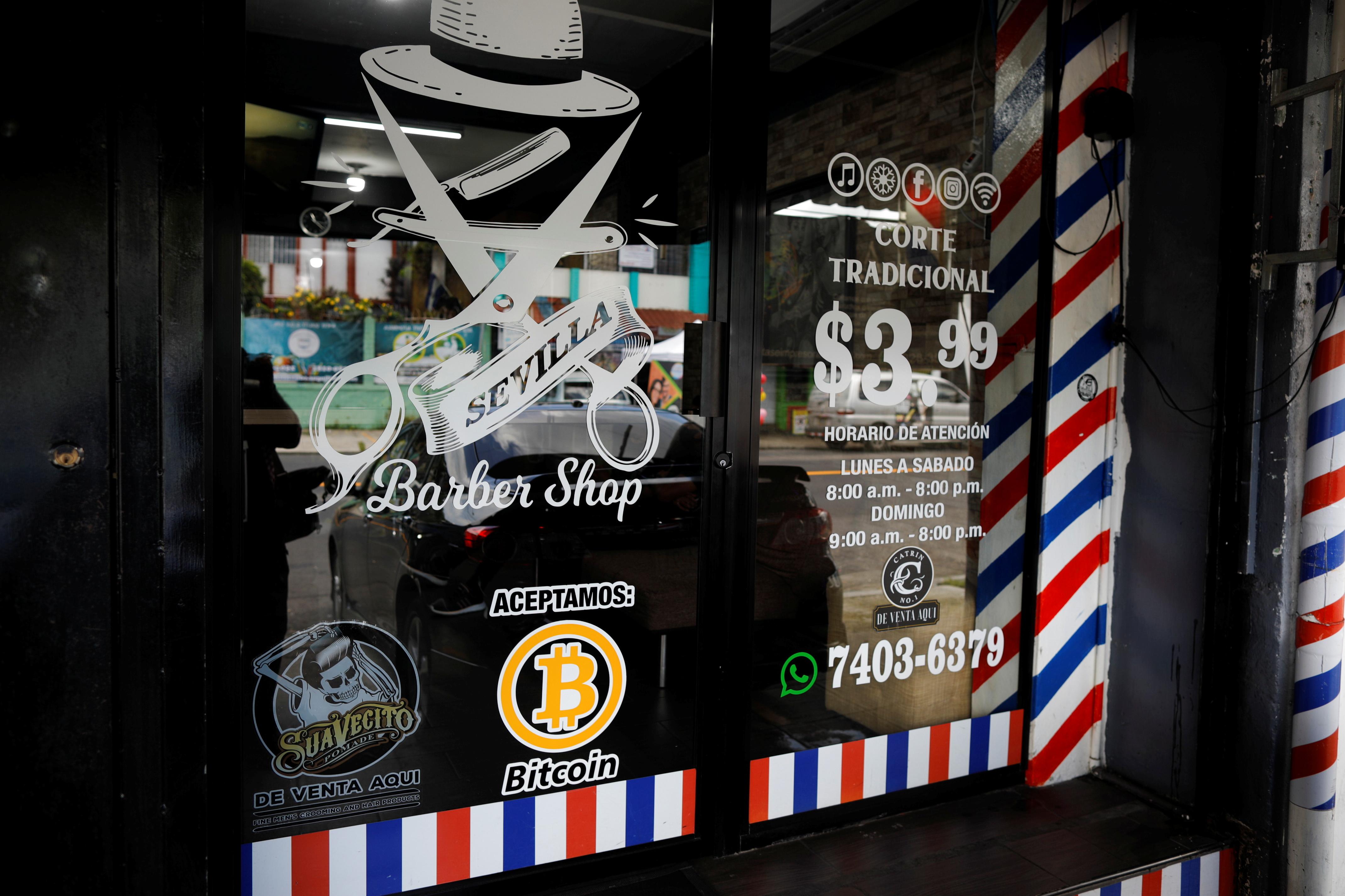 A Bitcoin logo is seen outside at Sevilla Barber Shop where Bitcoin is accepted as a payment method in Santa Tecla, El Salvador September 6, 2021. REUTERS/Jose Cabezas