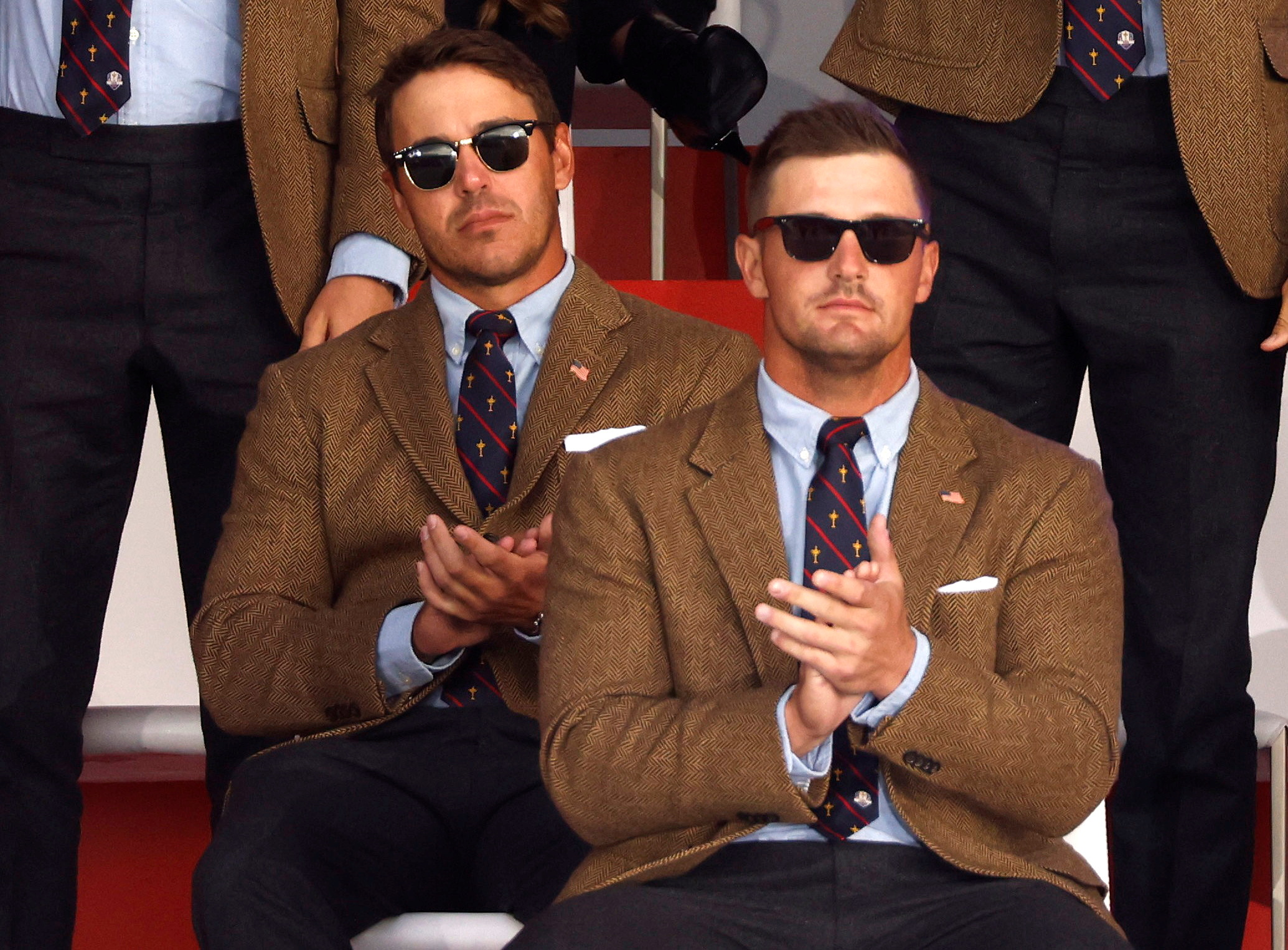 Golf - The 2020 Ryder Cup - Whistling Straits, Sheboygan, Wisconsin, U.S. - September 23, 2021 Team USA's Brooks Koepka and Team USA's Bryson DeChambeau during the opening ceremony REUTERS/Jonathan Ernst