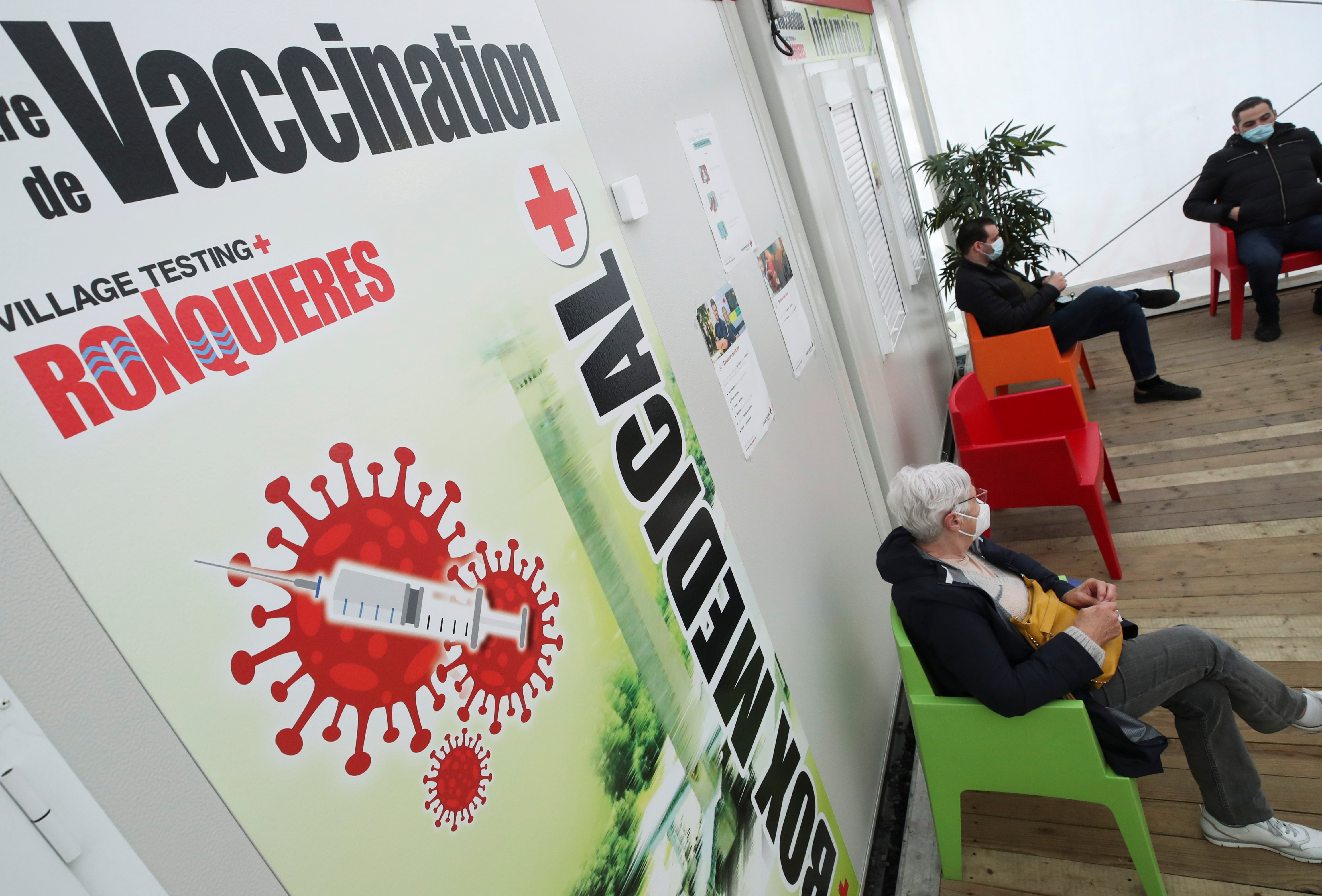 A woman sits as she waits at a COVID-19 vaccination centre, amid the coronavirus disease outbreak, in Ronquieres, Belgium March 15, 2021. REUTERS/Yves Herman