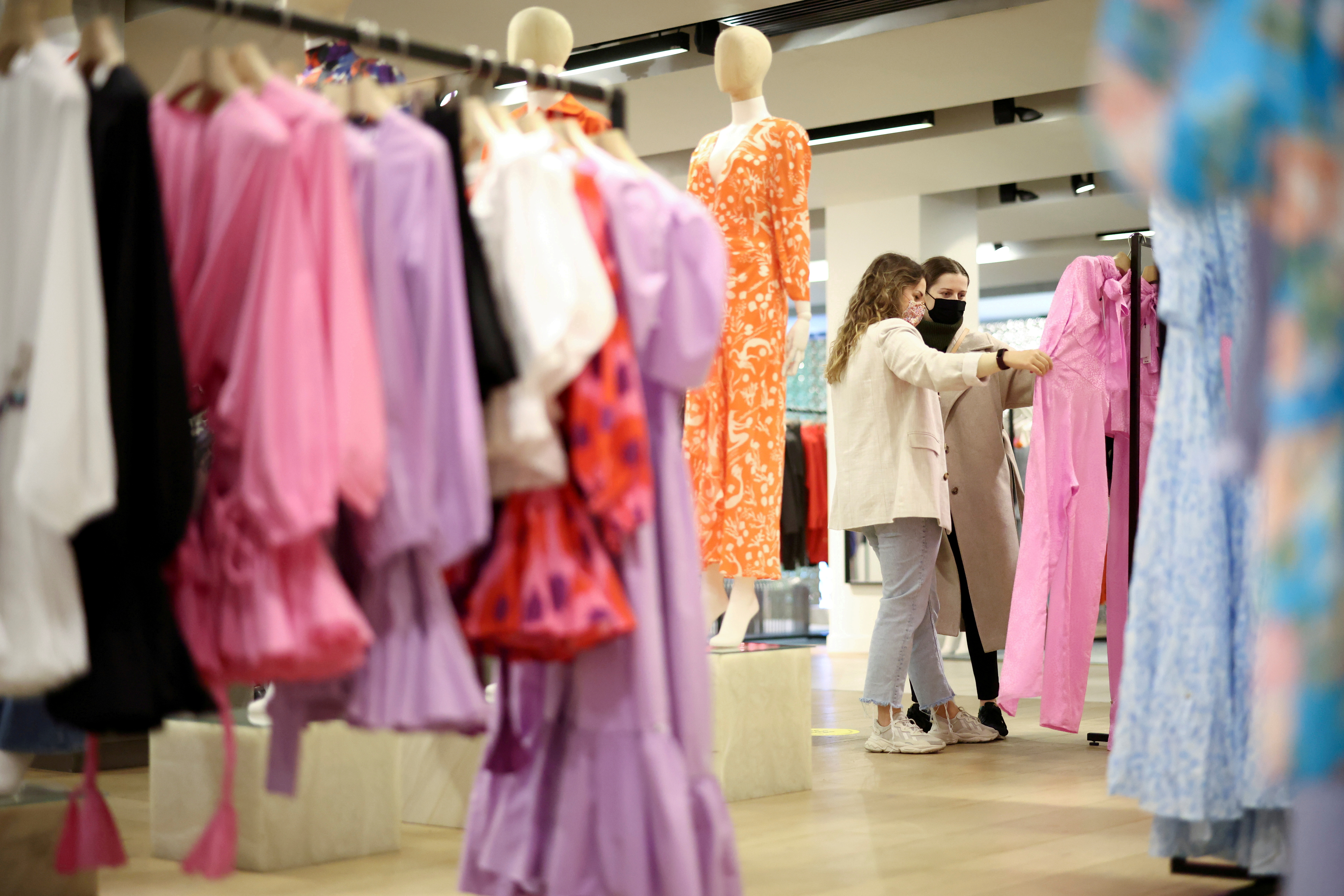 People shop in the Selfridges department store on Oxford street, as the coronavirus disease (COVID-19) restrictions ease, in London, Britain April 12, 2021. REUTERS/Henry Nicholls