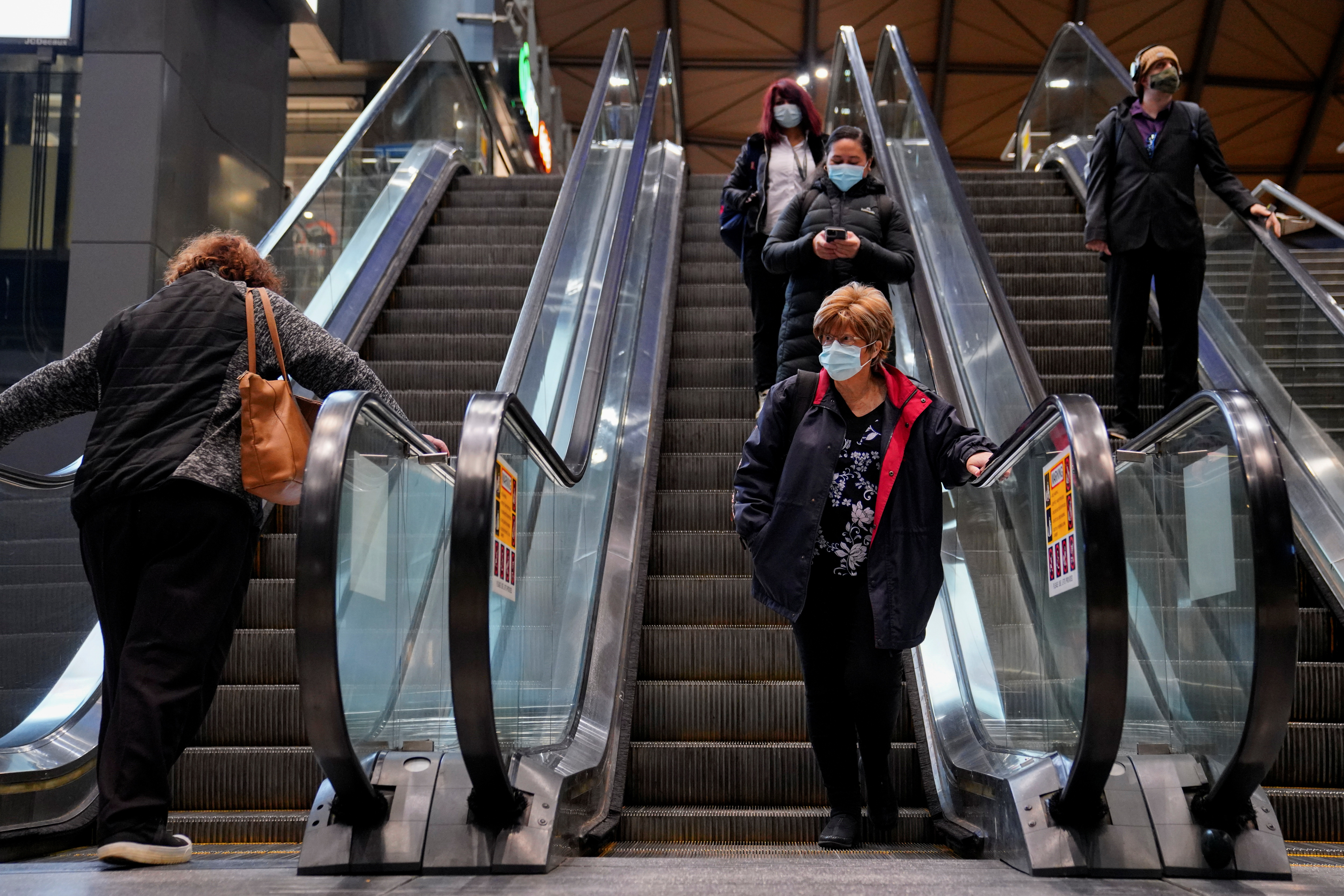Morning commuters exit Southern Cross Station on the first day of eased coronavirus disease (COVID-19) restrictions for the state of Victoria following an extended lockdown in Melbourne, Australia, June 11, 2021.  REUTERS/Sandra Sanders