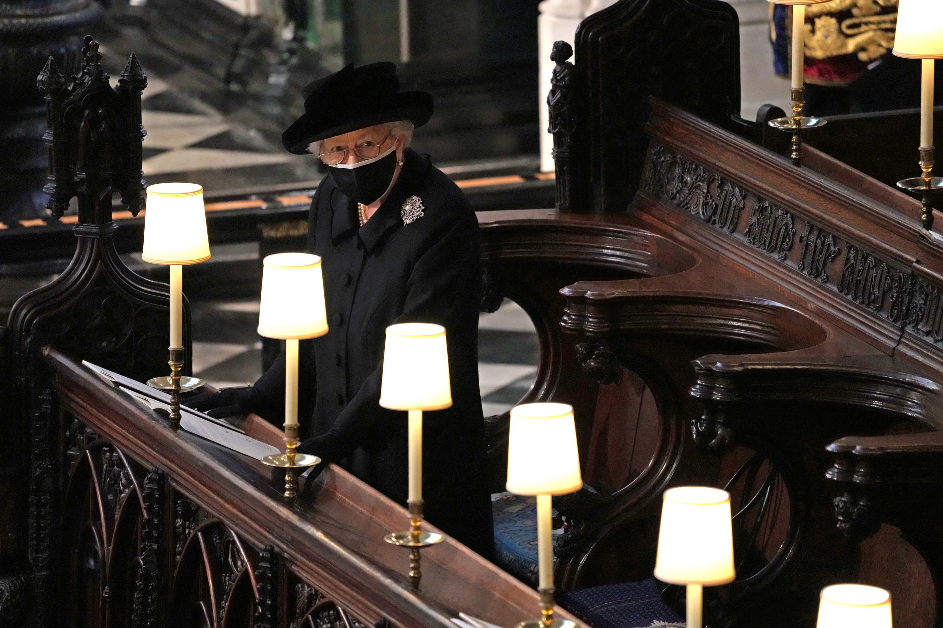 Britain's Queen Elizabeth is seen during the funeral of Britain's Prince Philip, husband of Queen Elizabeth, who died at the age of 99, at St George's Chapel, in Windsor, Britain, April 17, 2021. Yui Mok/Pool via REUTERS