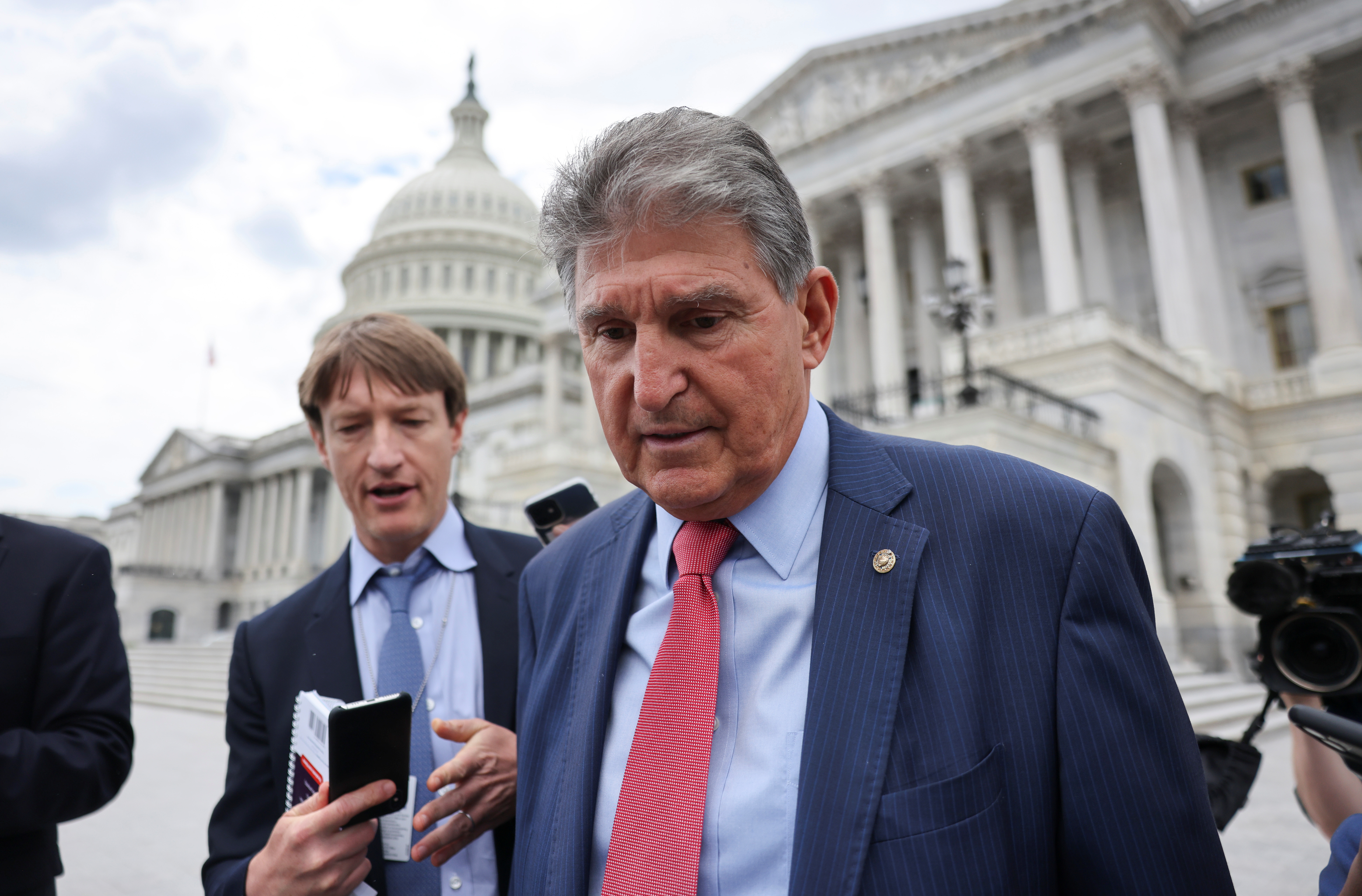 U.S. Senator Joe Manchin (D-WV) talks to reporters as he departs the U.S. Capitol after a vote in the Senate on Capitol Hill in Washington, U.S., June 10, 2021. REUTERS/Evelyn Hockstein