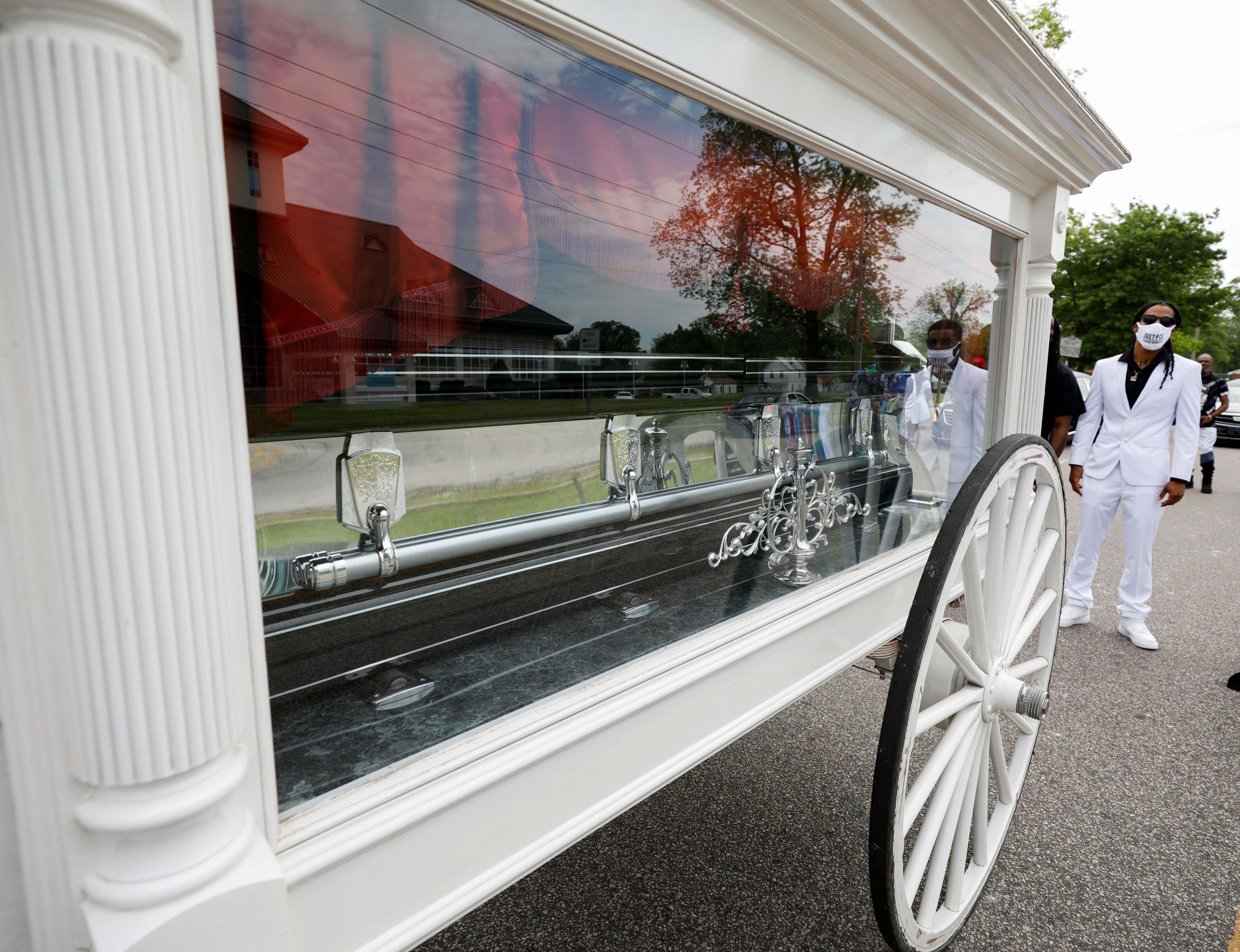 Khalil Ferebee, the son of Andrew Brown Jr., stands behind his father's casket after it was loaded into a horse-drawn cart bound for the funeral in Elizabeth City, North Carolina, U.S. May 3, 2021. REUTERS/Jonathan Drake