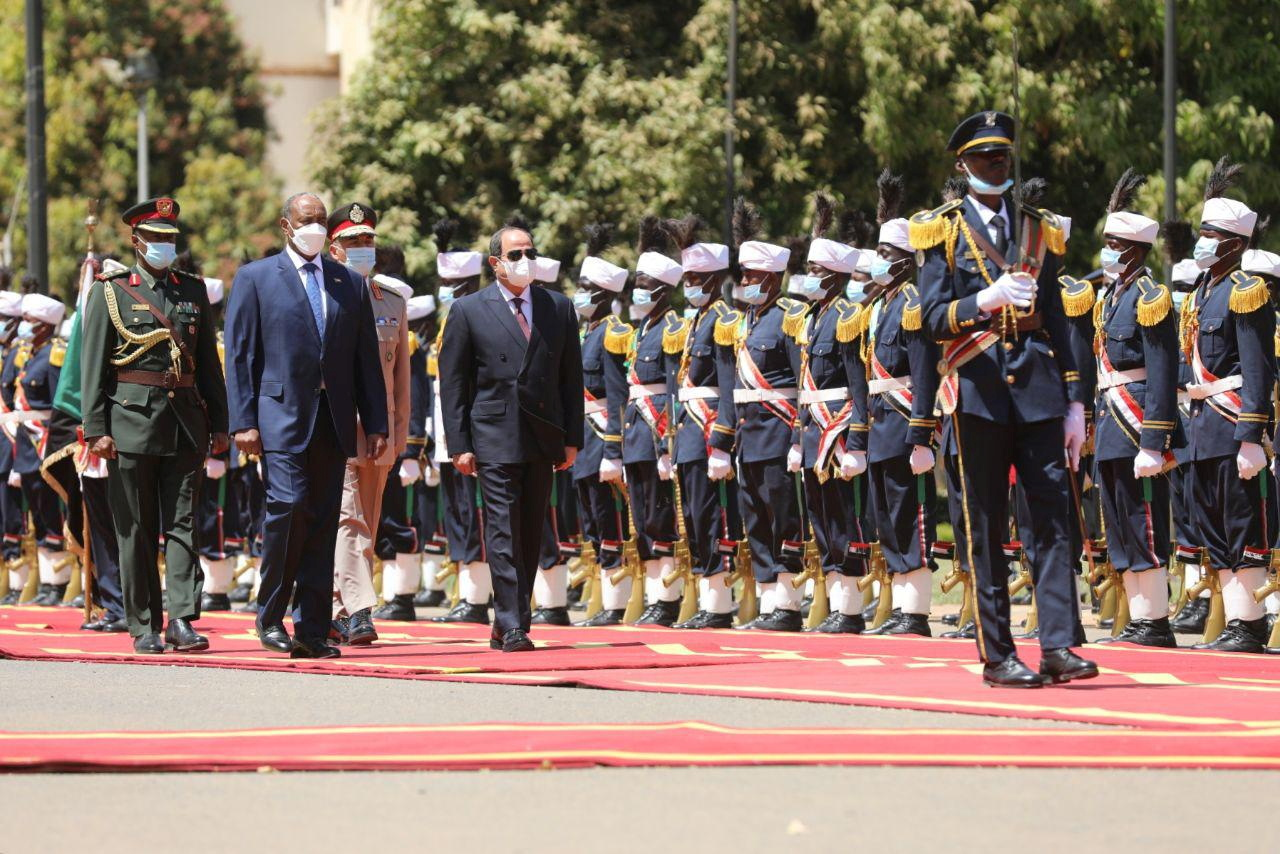 Sudan's Sovereign Council Chief General Abdel Fattah al-Burhan walks with Egyptian President Abdel Fatah al-Sisi, during a welcome ceremony in Khartoum, Sudan March 6, 2021. Sudan Sovereign Council/Handout via REUTERS
