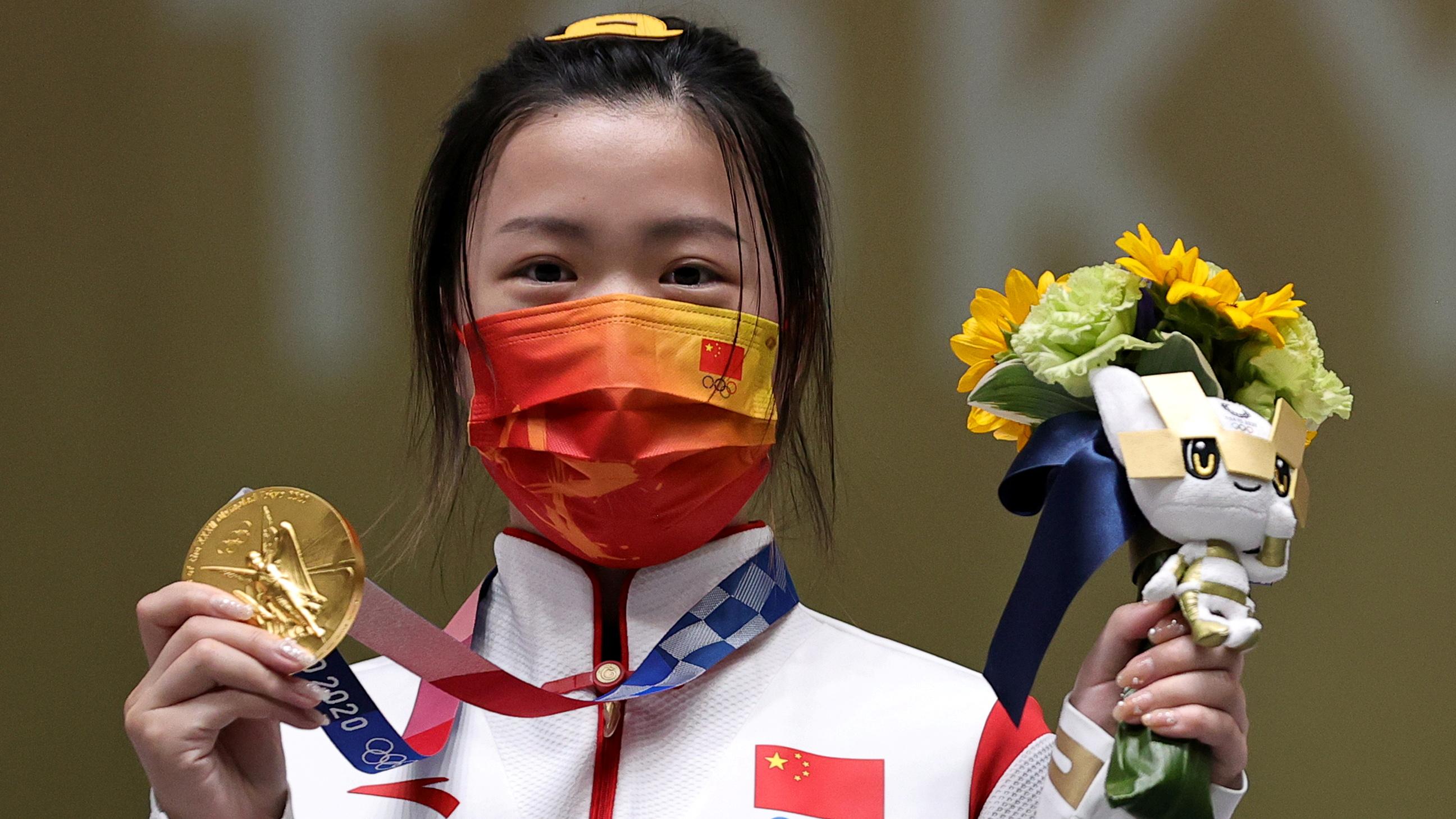Tokyo 2020 Olympics - Shooting - Women's 10m Air Rifle - Medal Ceremony - Asaka Shooting Range, Tokyo, Japan – July 24, 2021. Gold medallist Yang Qian of China celebrates on the podium REUTERS/Ann Wang