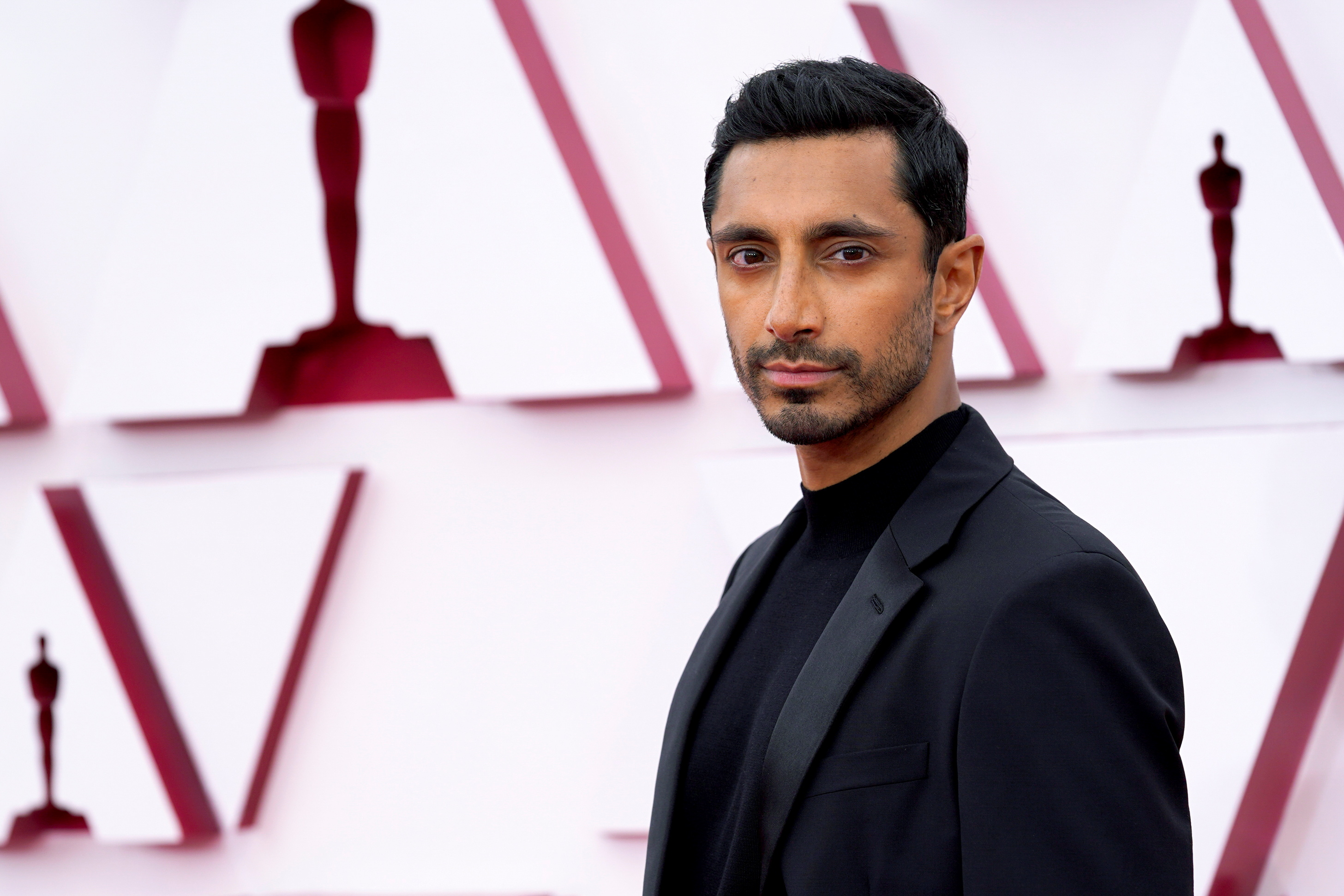 Riz Ahmed arrives to the Oscars red carpet for the 93rd Academy Awards in Los Angeles, California, U.S., April 25, 2021. Chris Pizzello/Pool via REUTERS