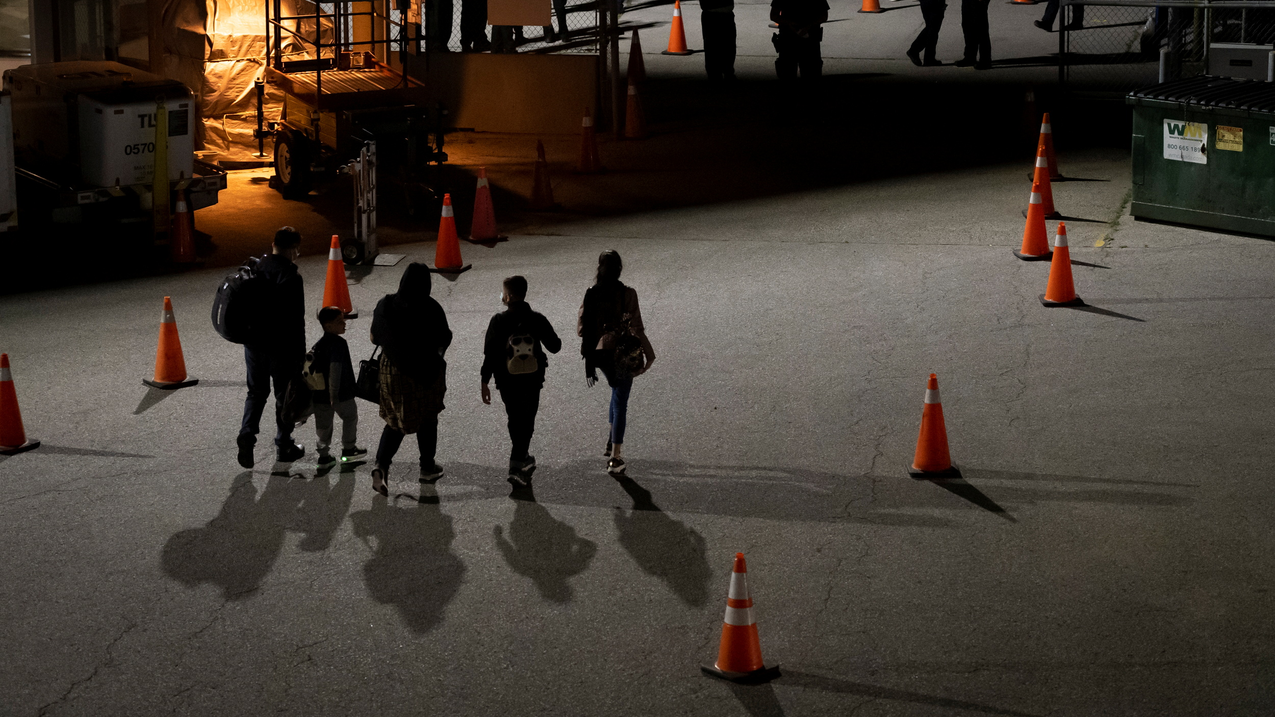 Afghan refugees who supported Canada's mission in Afghanistan walk on the tarmac after arriving in Canada at Toronto Pearson International Airport in Mississauga, Ontario, Canada August 11, 2021. Cpl Rachael Allen/Canadian Forces Combat Camera/Handout via REUTERS.
