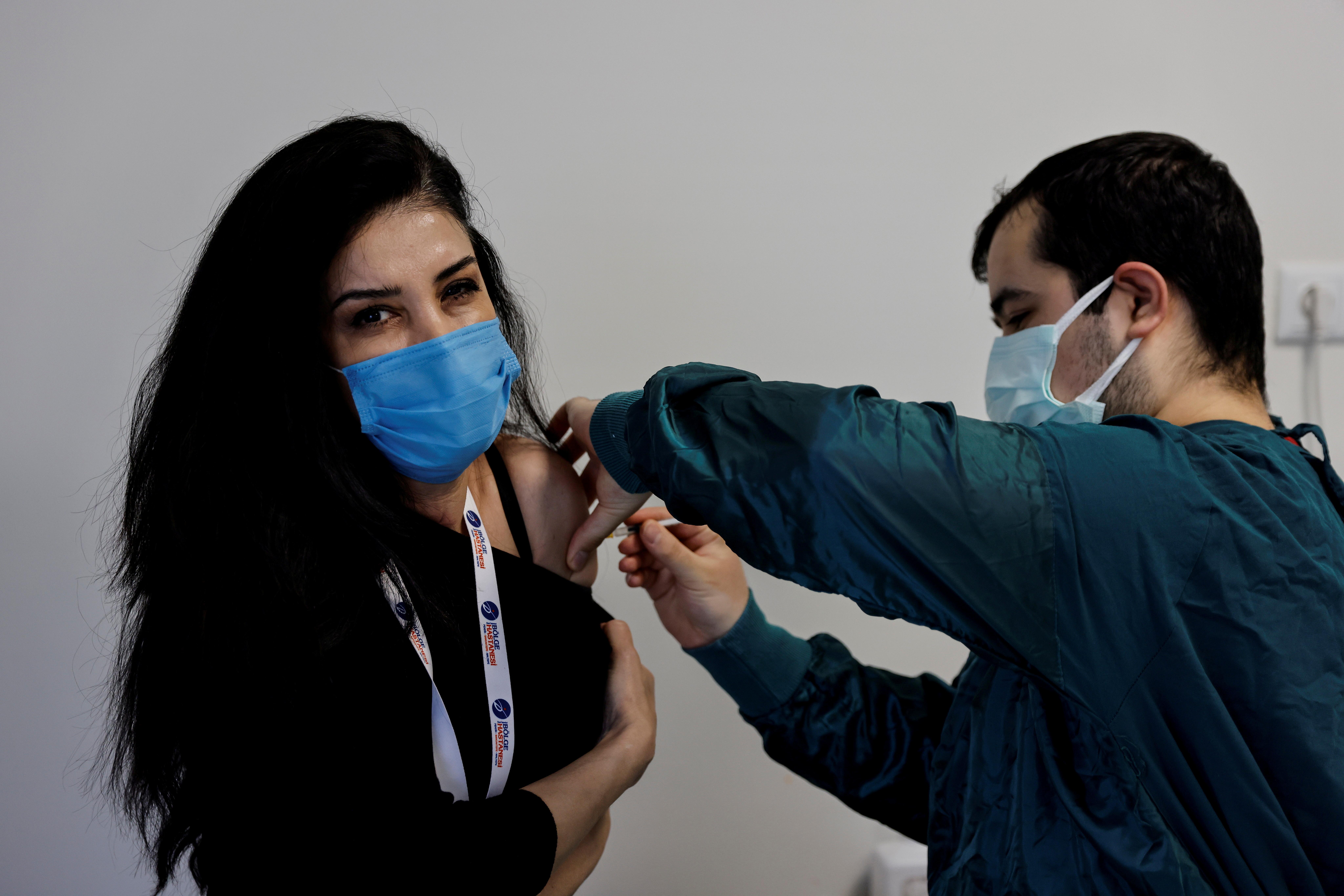 Senay Salman receives a shot of the Pfizer-BioNTech coronavirus disease (COVID-19) vaccine at Dr. Feriha Oz Emergency Hospital in Istanbul, Turkey, April 9, 2021. REUTERS/Umit Bektas/File Photo