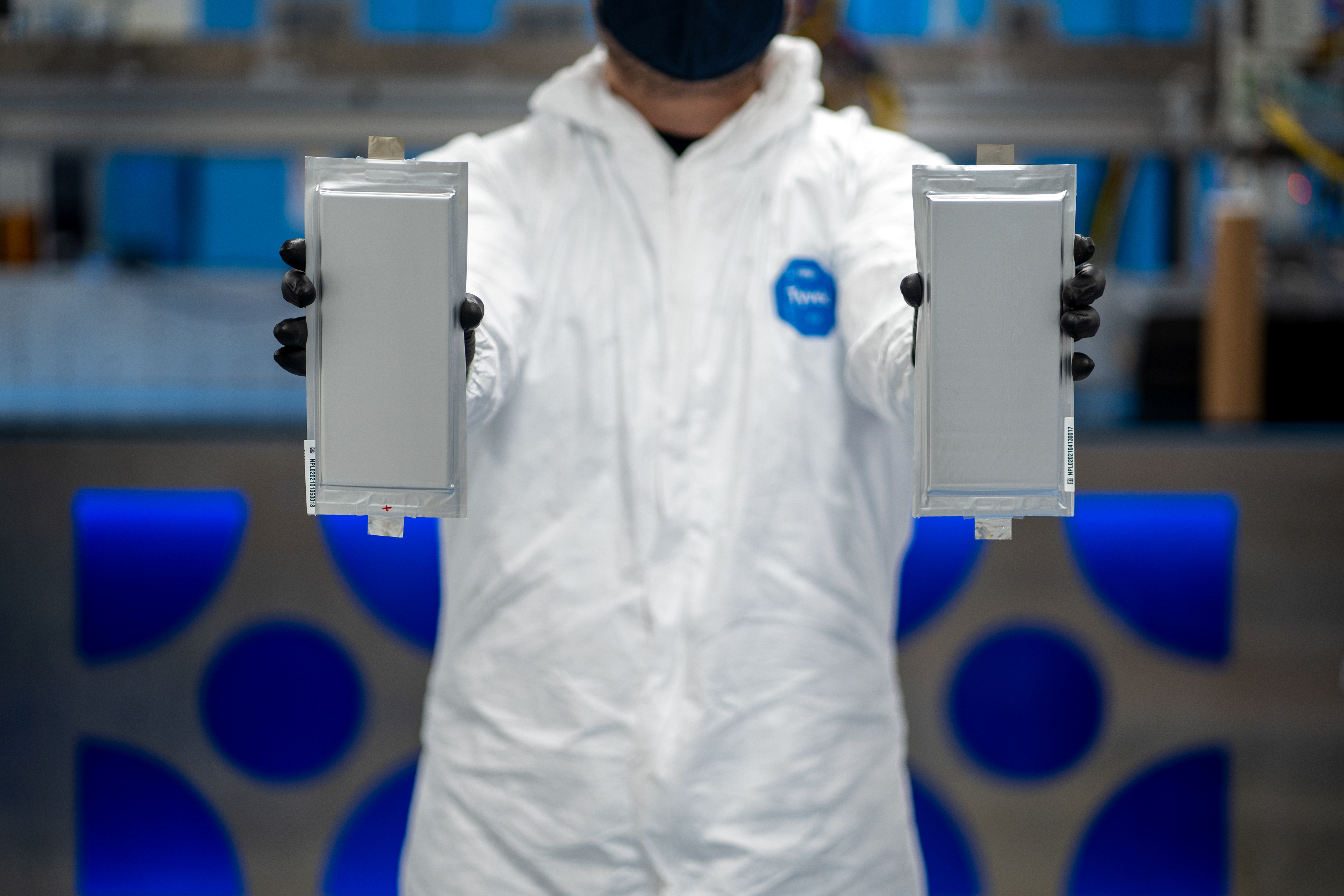A Solid Power manufacturing engineer holds two 20 ampere hour (Ah) all solid-state battery cells for the BMW Group and Ford Motor Company, at Solid Power's pilot production line in Louisville, Colorado, U.S. April 23, 2021. Picture taken April 23, 2021. Will McKenna/Solid Power/Handout via REUTERS