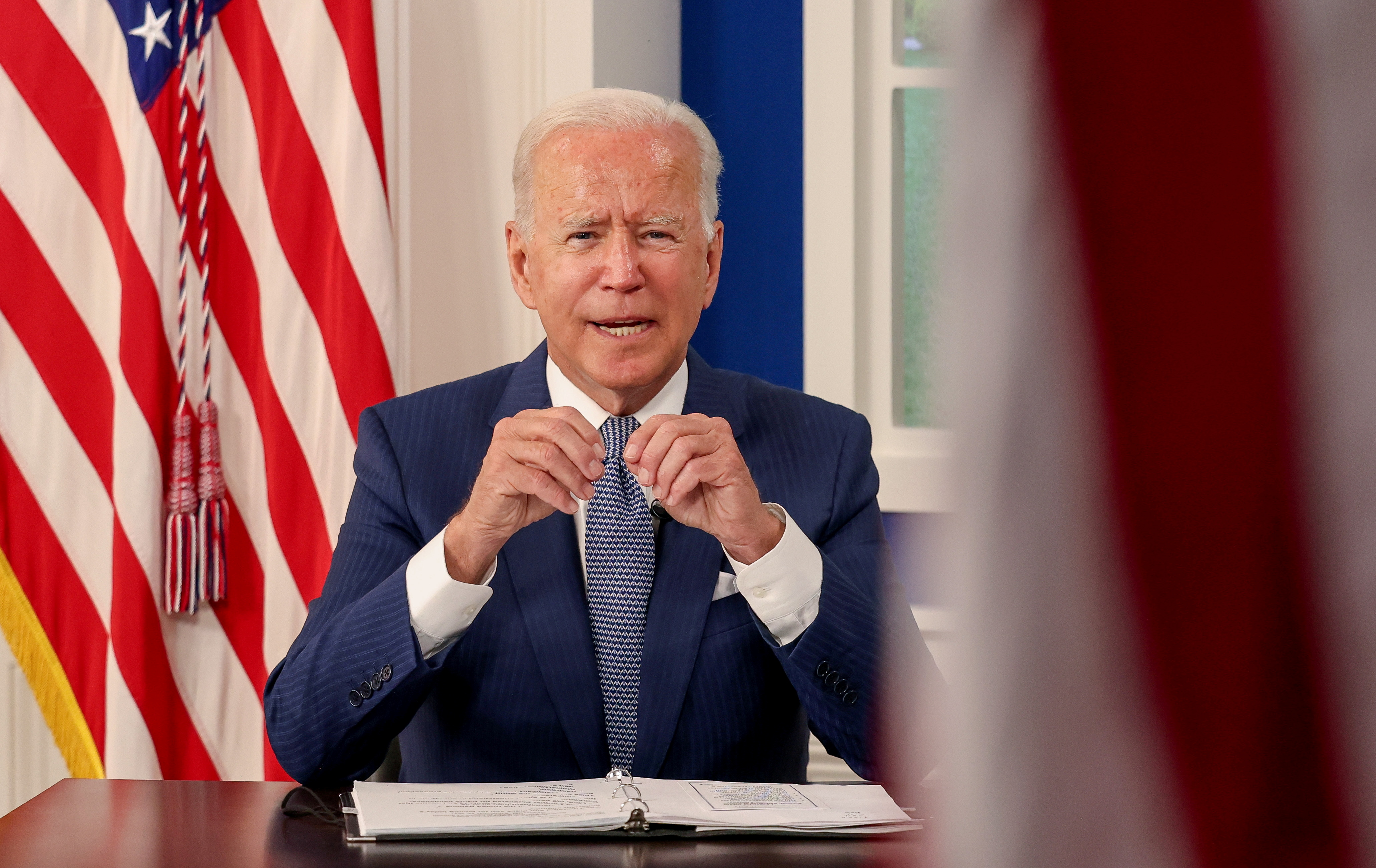 U.S. President Joe Biden hosts a virtual coronavirus disease (COVID-19) Summit as part of the United Nations General Assembly (UNGA) from the White House in Washington, U.S., September 22, 2021.REUTERS/Evelyn Hockstein
