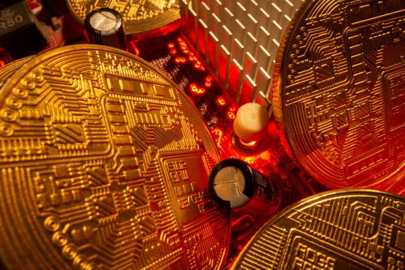 Representations of the virtual currency stand on a motherboard in this picture illustration taken May 20, 2021. REUTERS/Dado Ruvic/Illustration