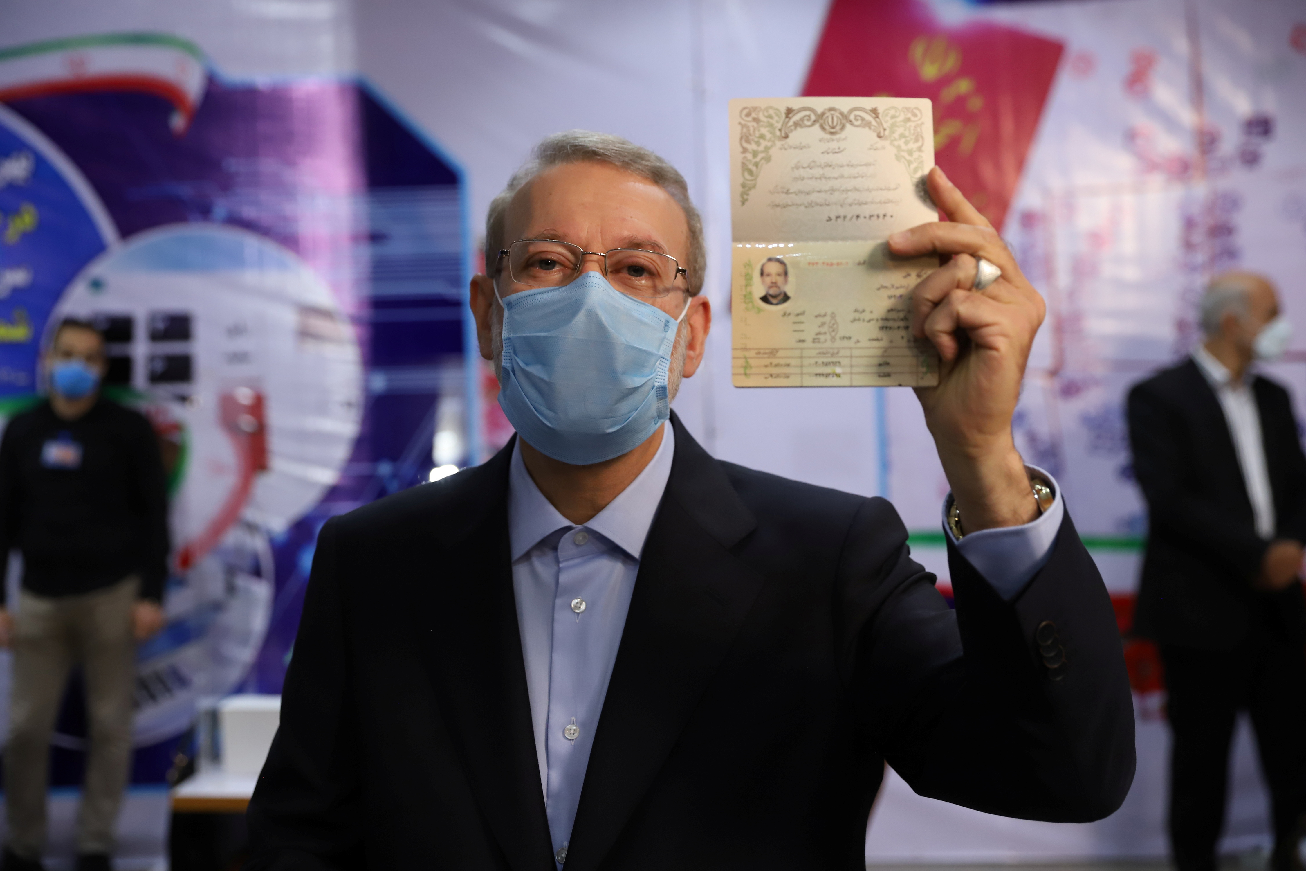 Ali Larijani, former chairman of the parliament of Iran, shows his identification document as he registers as a candidate for the presidential election at the Interior Ministry, in Tehran, Iran May 15, 2021. Majid Asgaripour/ WANA (West Asia News Agency) via REUTERS