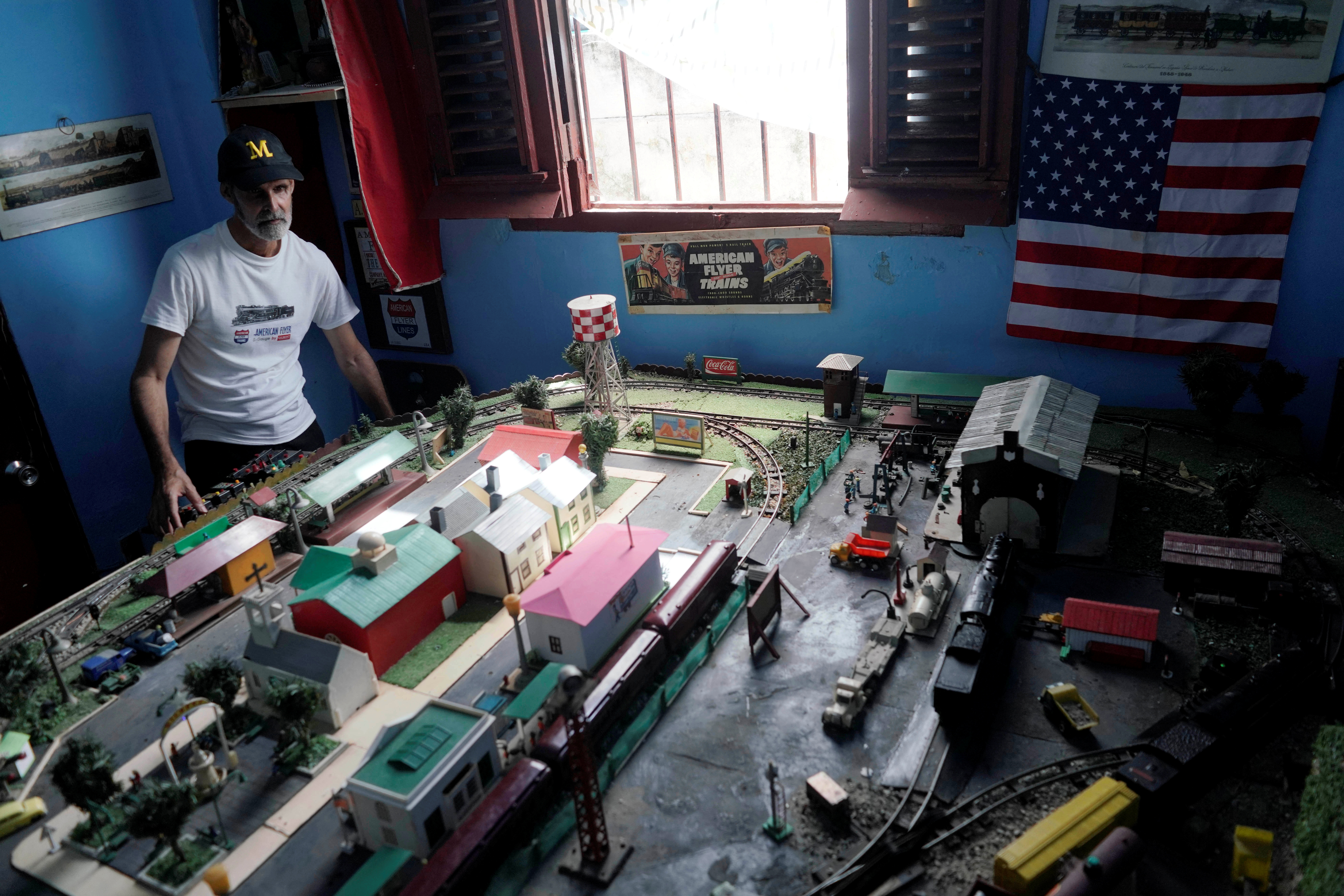 Miguel Jorda, 56, shows his model trains at his home in Havana, Cuba, May 7, 2021. Picture taken on May 7, 2021. REUTERS/Alexandre Meneghini