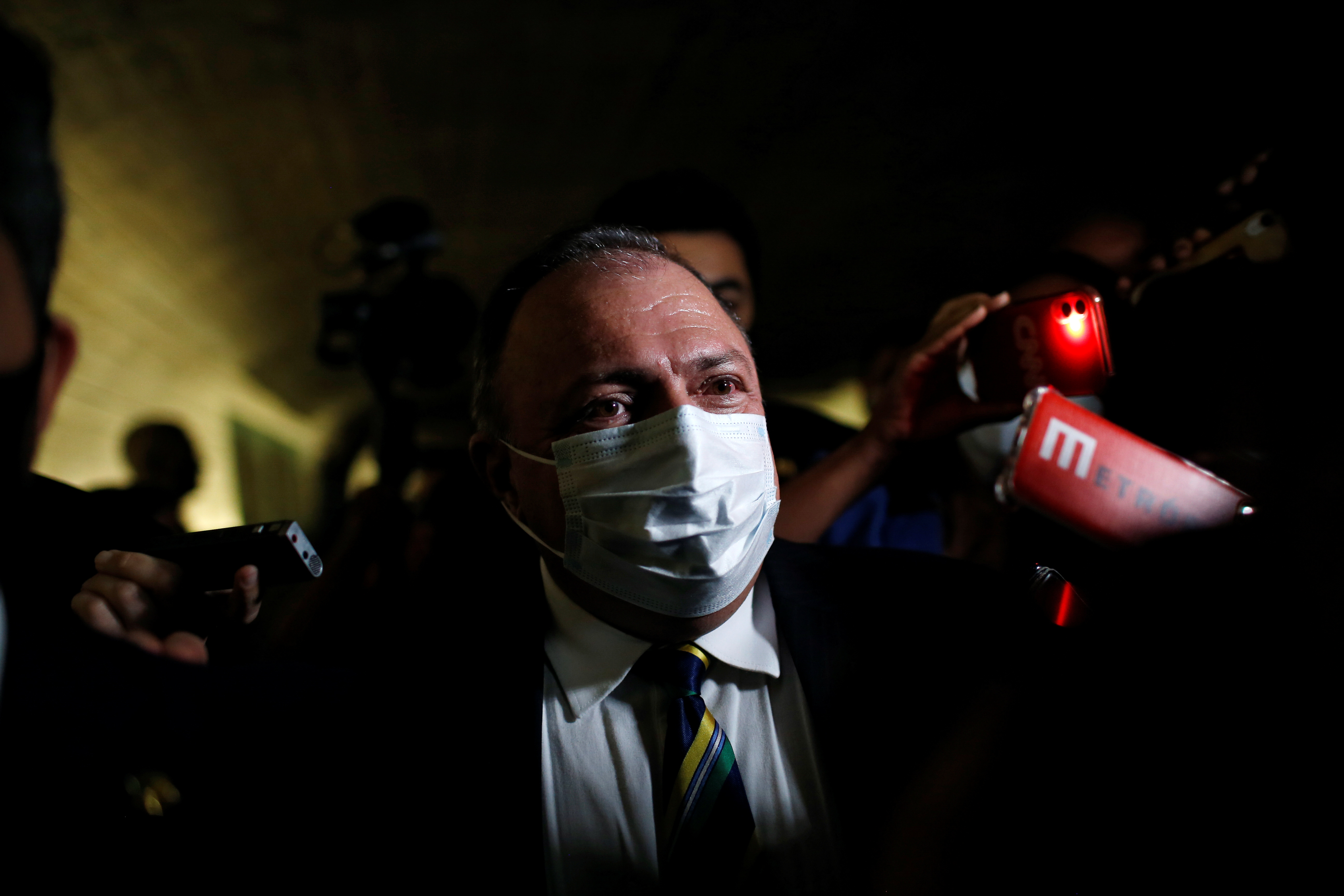 Former Brazil's Health Minister Eduardo Pazuello is seen after a meeting of the Parliamentary Inquiry Committee (CPI) to investigate government actions and management during the coronavirus disease (COVID-19) pandemic, at the Federal Senate in Brasilia, Brazil May 19, 2021. REUTERS/Adriano Machado
