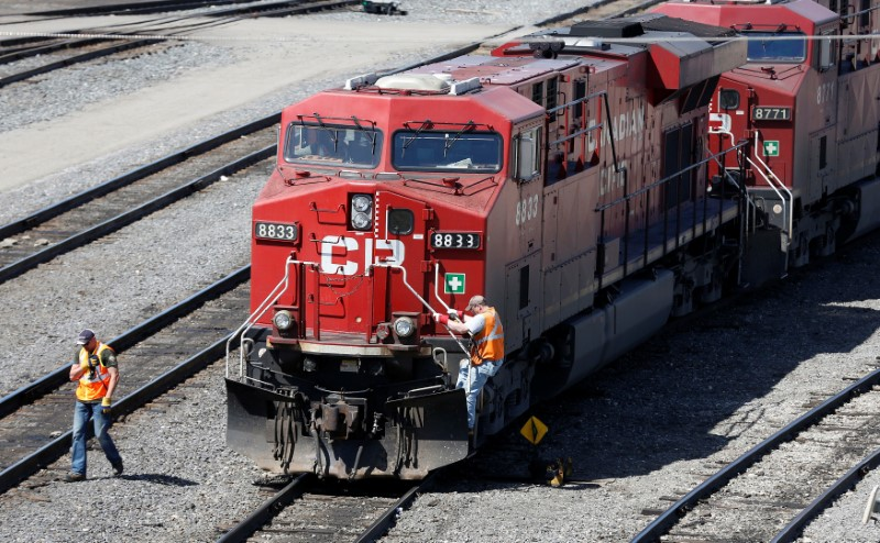 A Canadian Pacific Railway crew works on their train at the CP Rail yards in Calgary, Alberta, April 29, 2014. REUTERS/Todd Korol
