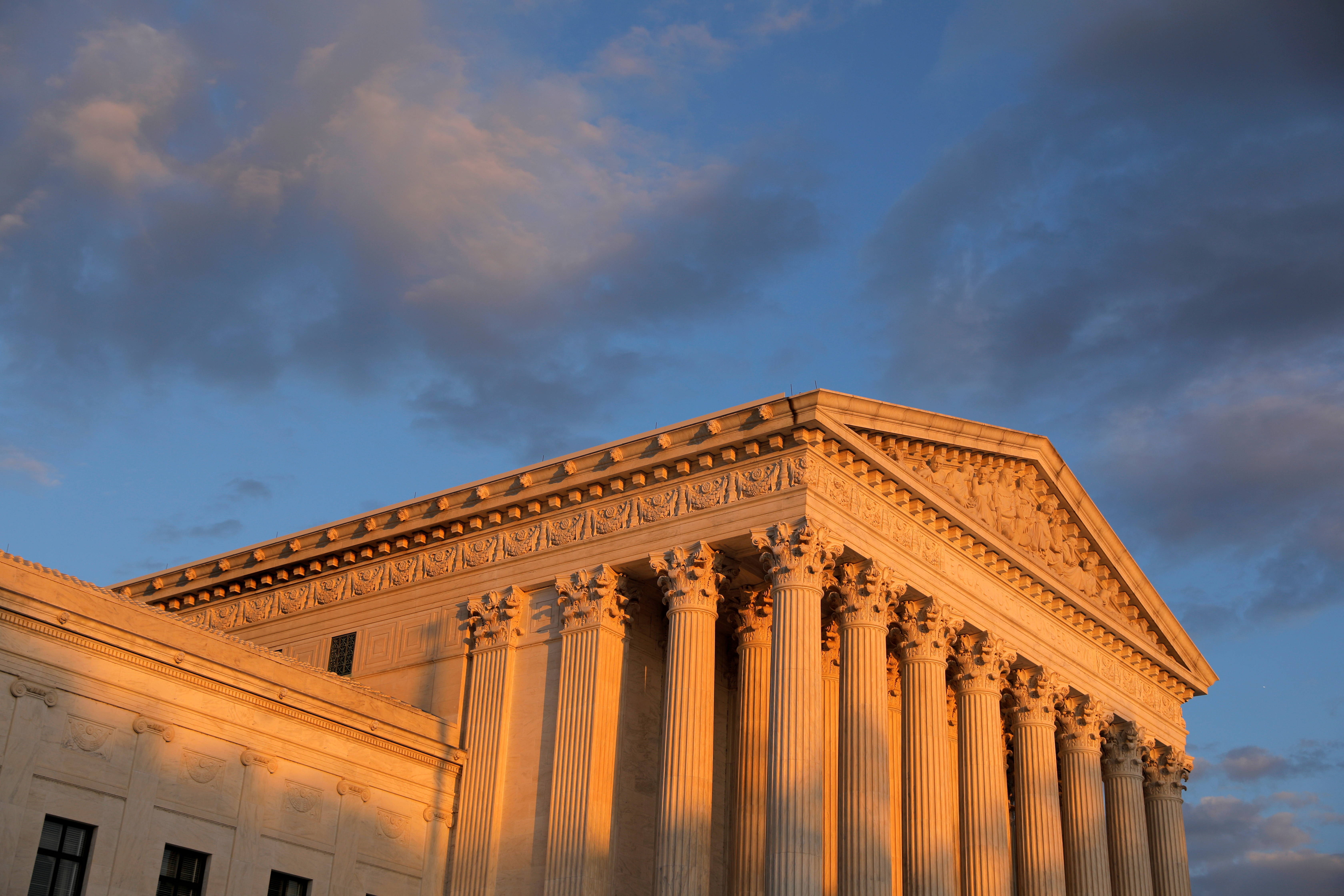 Light from the sunset shines on the United States Supreme Court Building in Washington, D.C.. REUTERS/Andrew Kelly