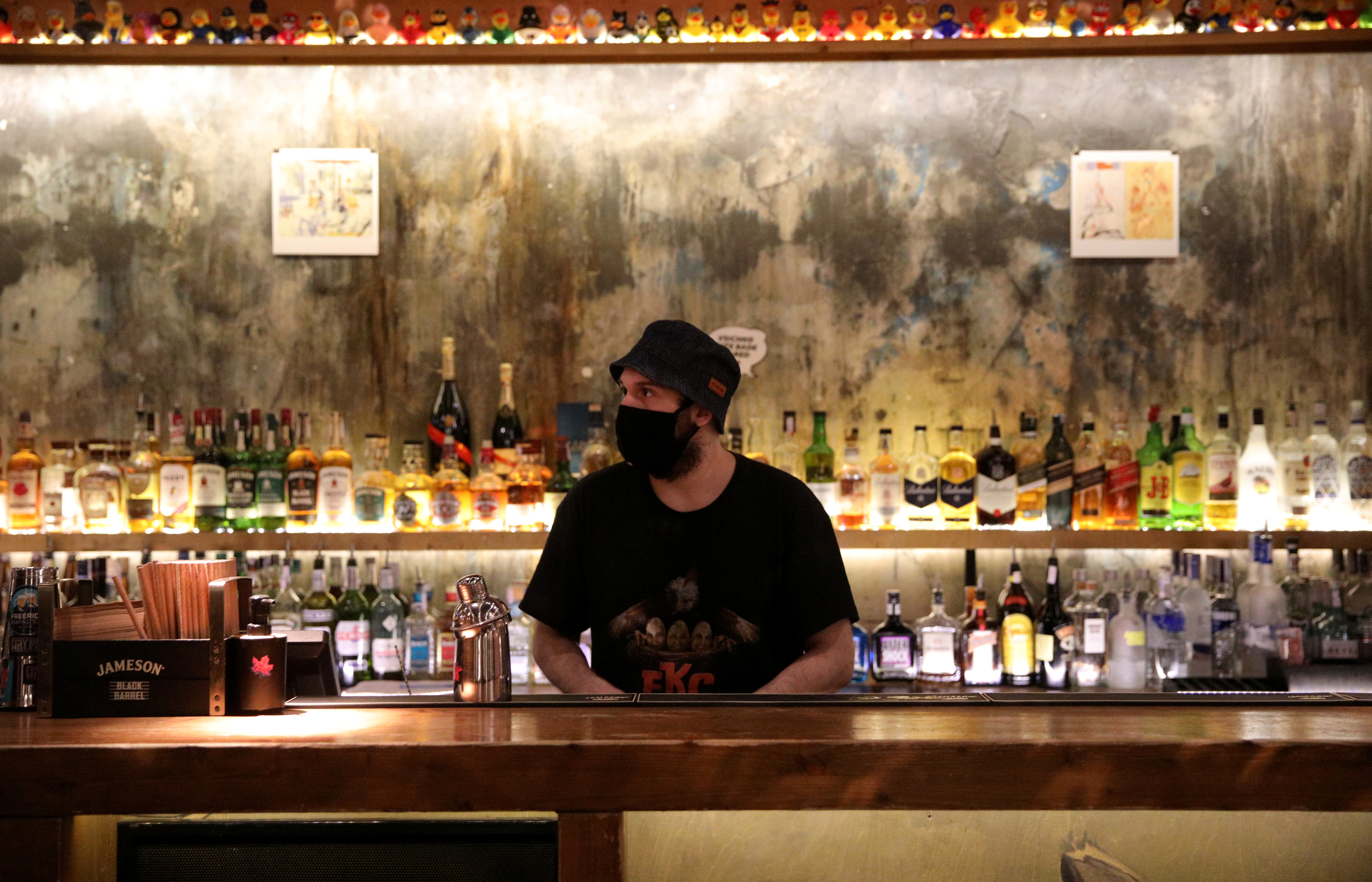 A bartender wearing a protective face mask is pictured at Bar Friday, as night clubs reopen at 50 percent capacity, following the outbreak of the coronavirus disease (COVID-19), in Sofia, Bulgaria, April 29, 2021.  REUTERS/Spasiyana Sergieva