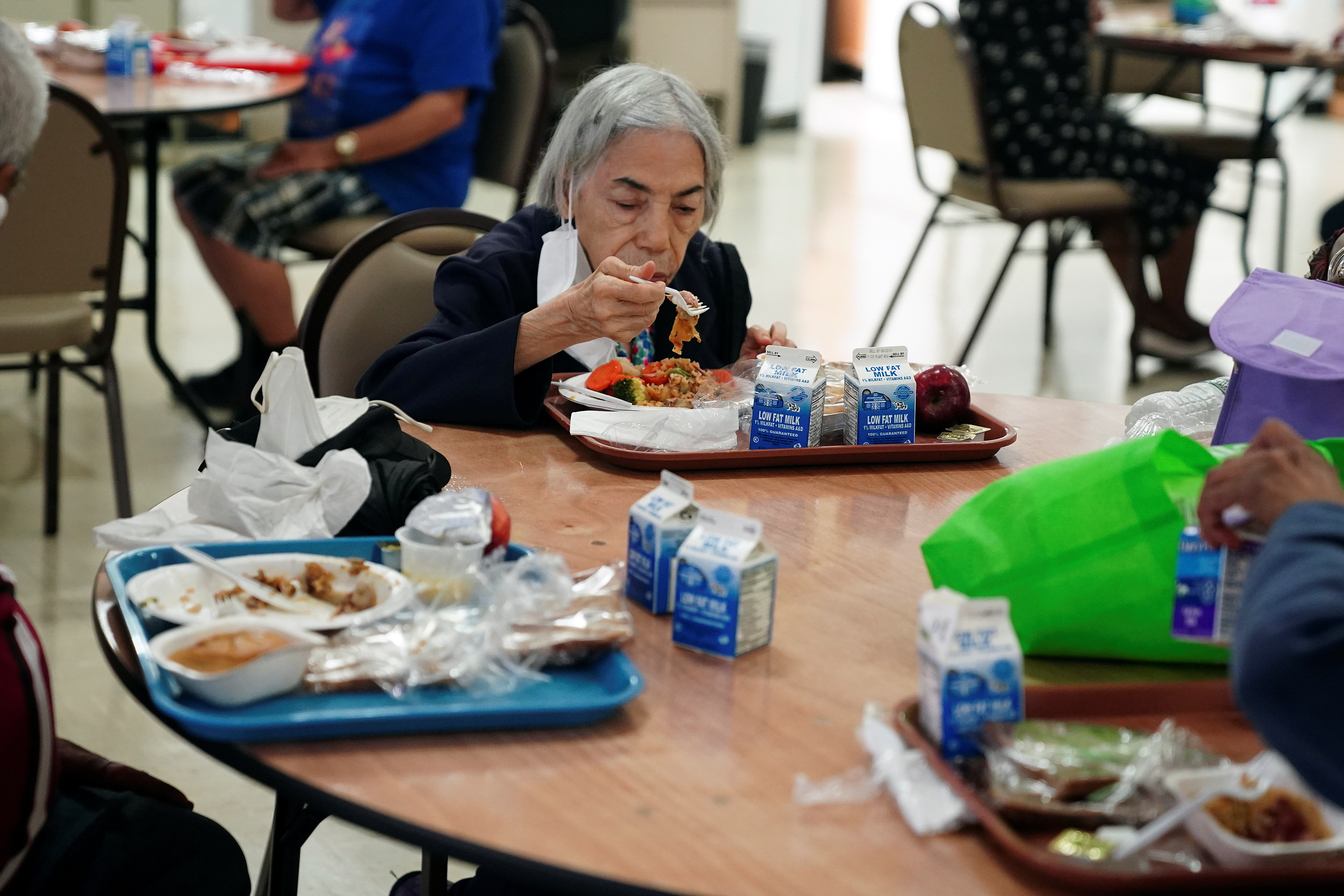 People eat lunch at the S.T.A.R. Senior Center in New York City, New York, U.S., June 14, 2021. Picture taken June 14, 2021.  REUTERS/Carlo Allegri