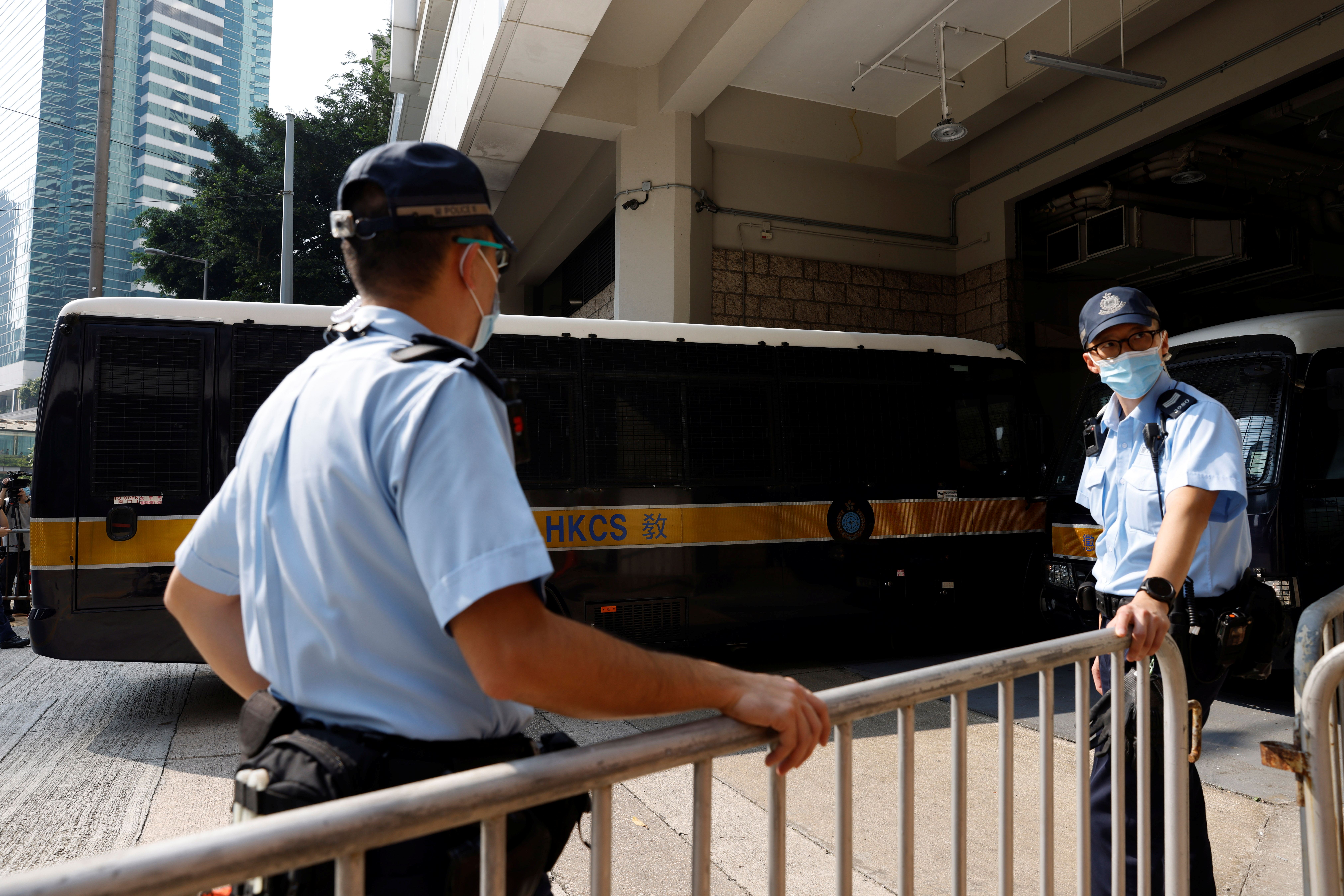 A prison van carrying Tong Ying-kit, the first person charged under the new national security law, arrives at High Court for a hearing, in Hong Kong, China, July 27, 2021. REUTERS/Tyrone Siu