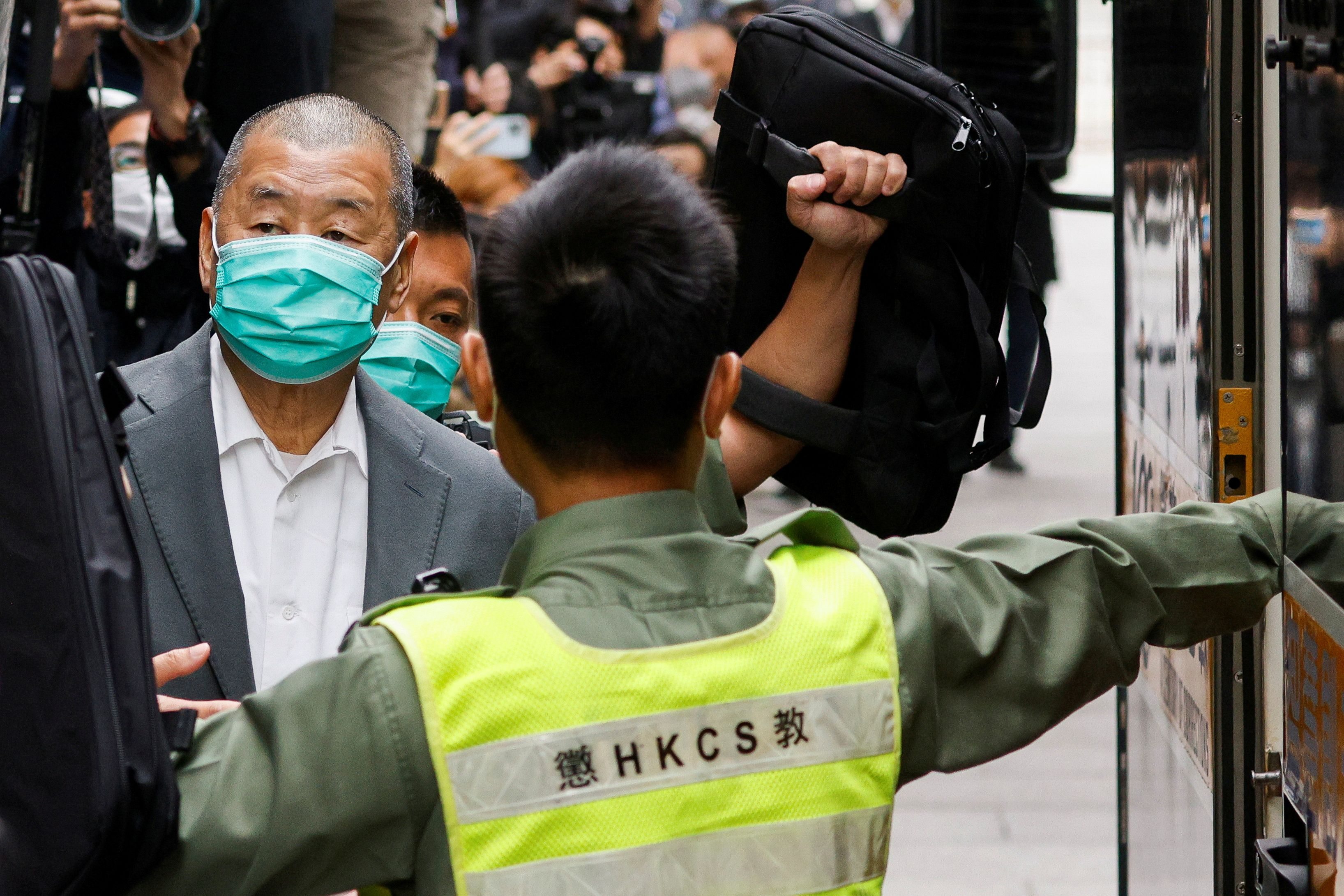 Media mogul Jimmy Lai, founder of Apple Daily, leaves the Court of Final Appeal by prison van in Hong Kong, China February 9, 2021. REUTERS/Tyrone Siu/File Photo