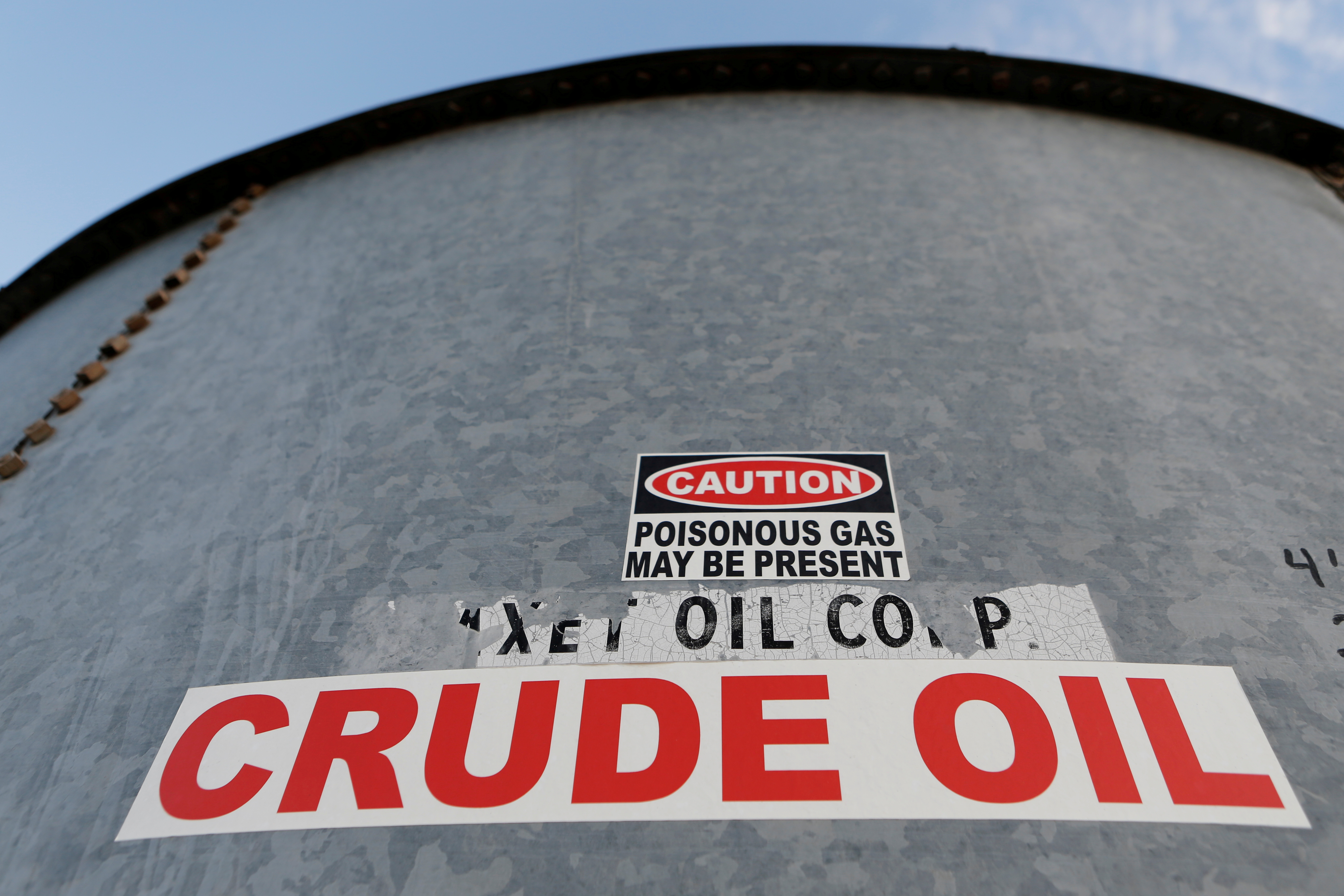 A sticker reads crude oil on the side of a storage tank in the Permian Basin in Mentone, Loving County, Texas, U.S. November 22, 2019.   REUTERS/Angus Mordant/File Photo