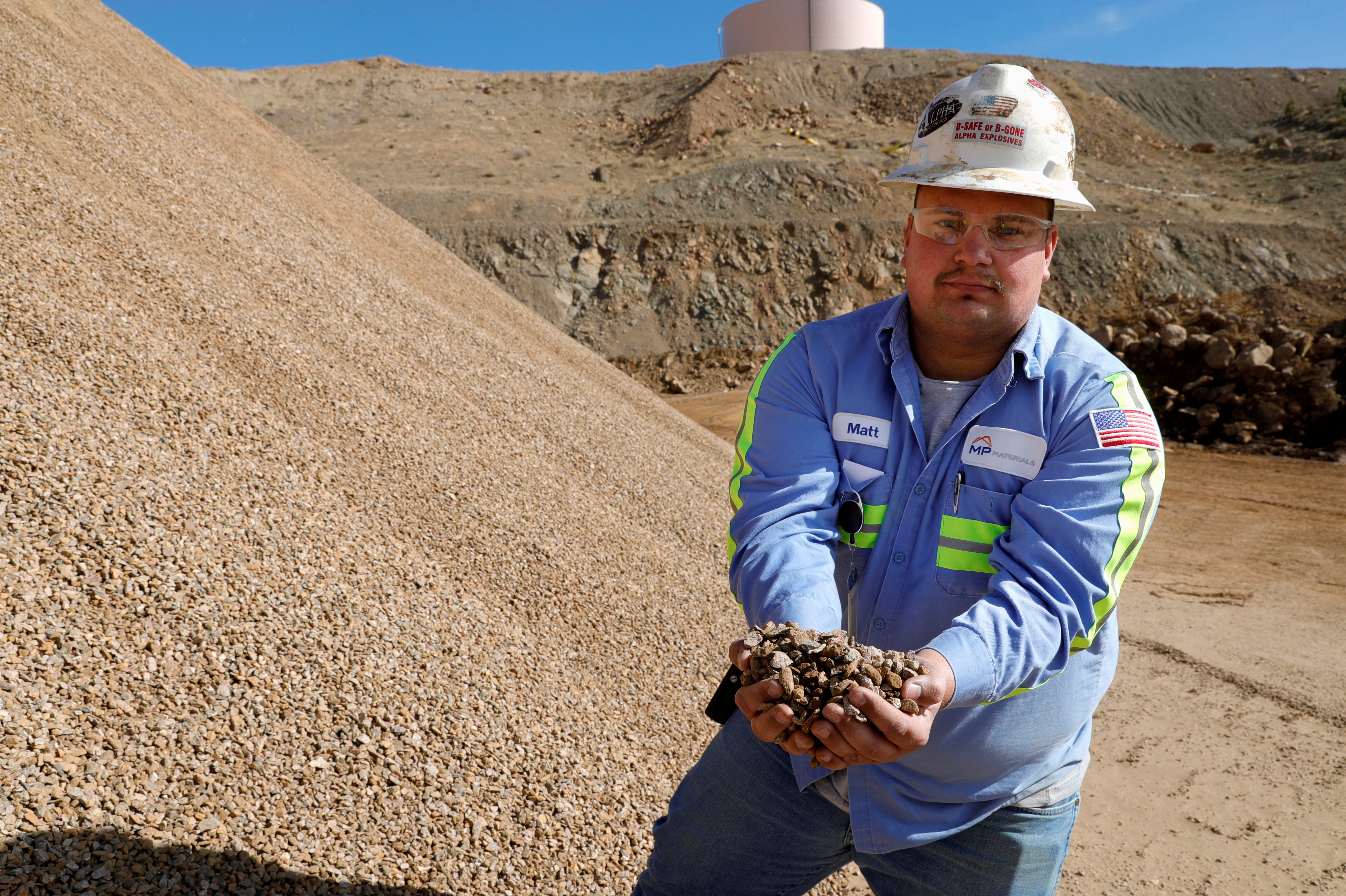 Matt Green, mining/crushing supervisor at MP Materials, displays crushed ore before it is sent to the mill at the MP Materials rare earth mine in Mountain Pass, California, U.S. January 30, 2020. REUTERS/Steve Marcus