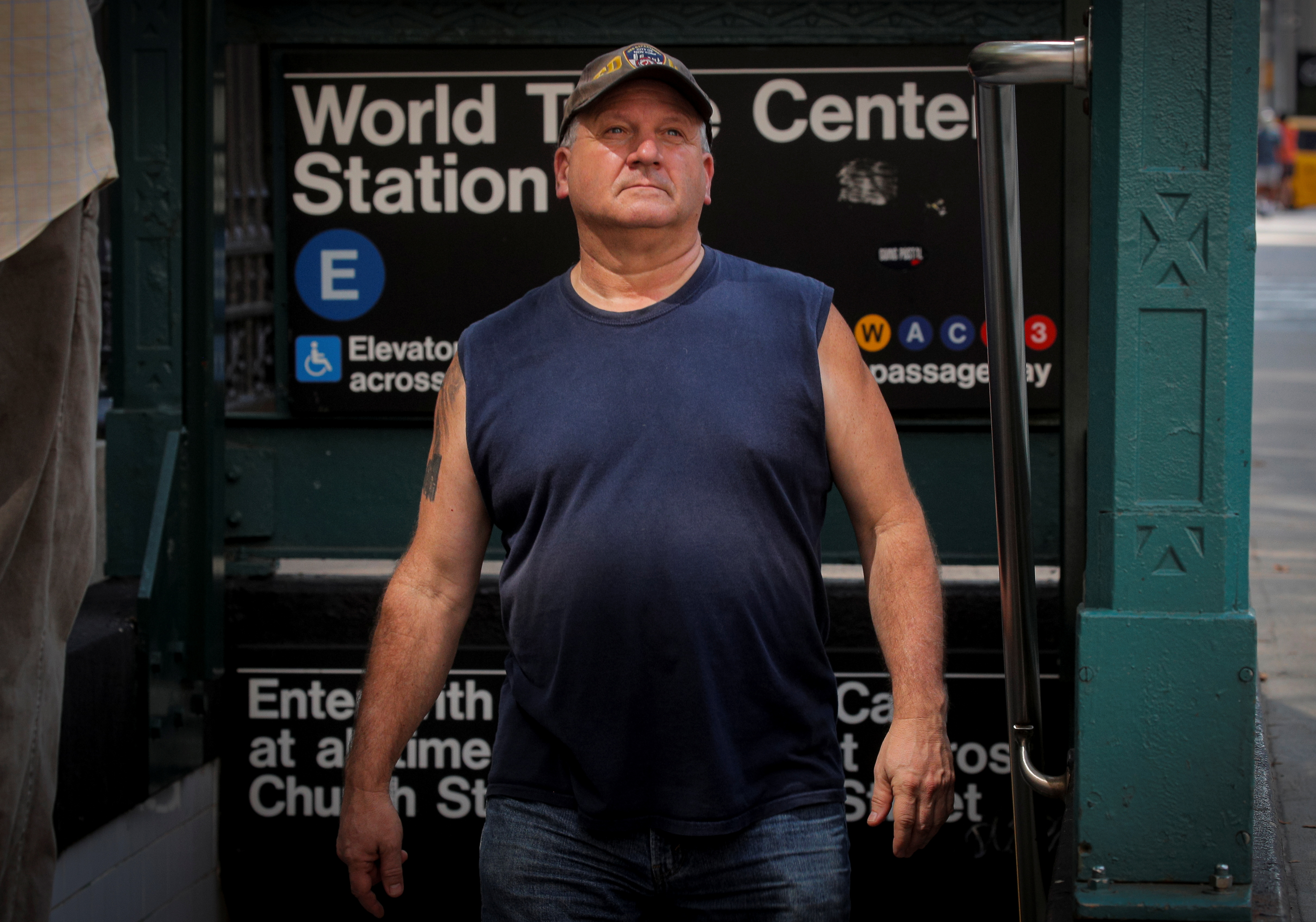Tom Canavan, who worked on the 47th floor of 1 World Trade Center, exits the subway station near the spot where he was buried alive when the first tower fell on 9/11, during an interview near the National September 11 Memorial & Museum in New York City, New York, U.S., August 25, 2021.  REUTERS/Brendan McDermid