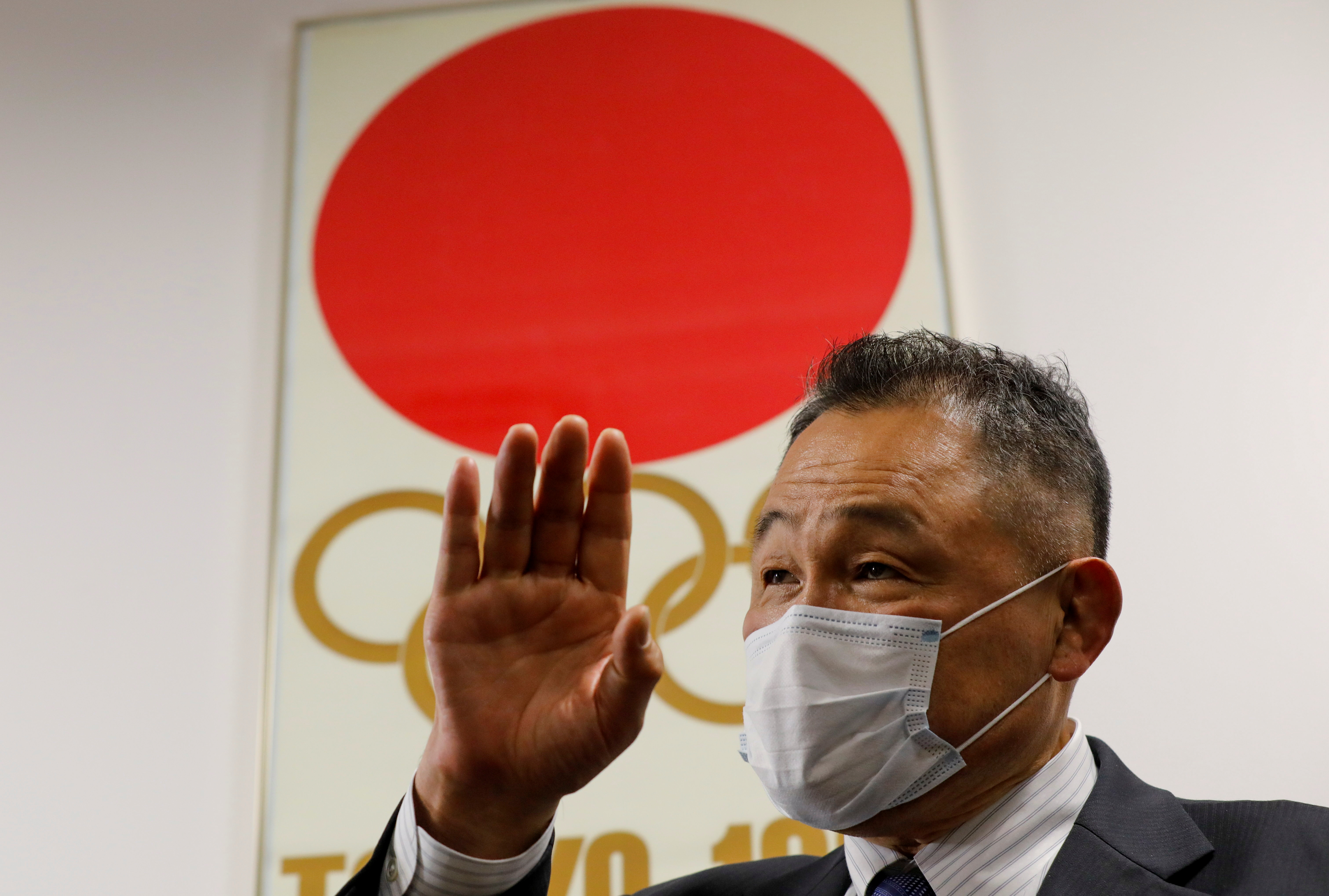 President of Japanese Olympic Committee Yasuhiro Yamashita wearing a protective mask, amid the coronavirus disease (COVID-19) outbreak, speaks during an interview with Reuters in Tokyo, Japan, January 22, 2021. REUTERS/Kim Kyung-Hoon