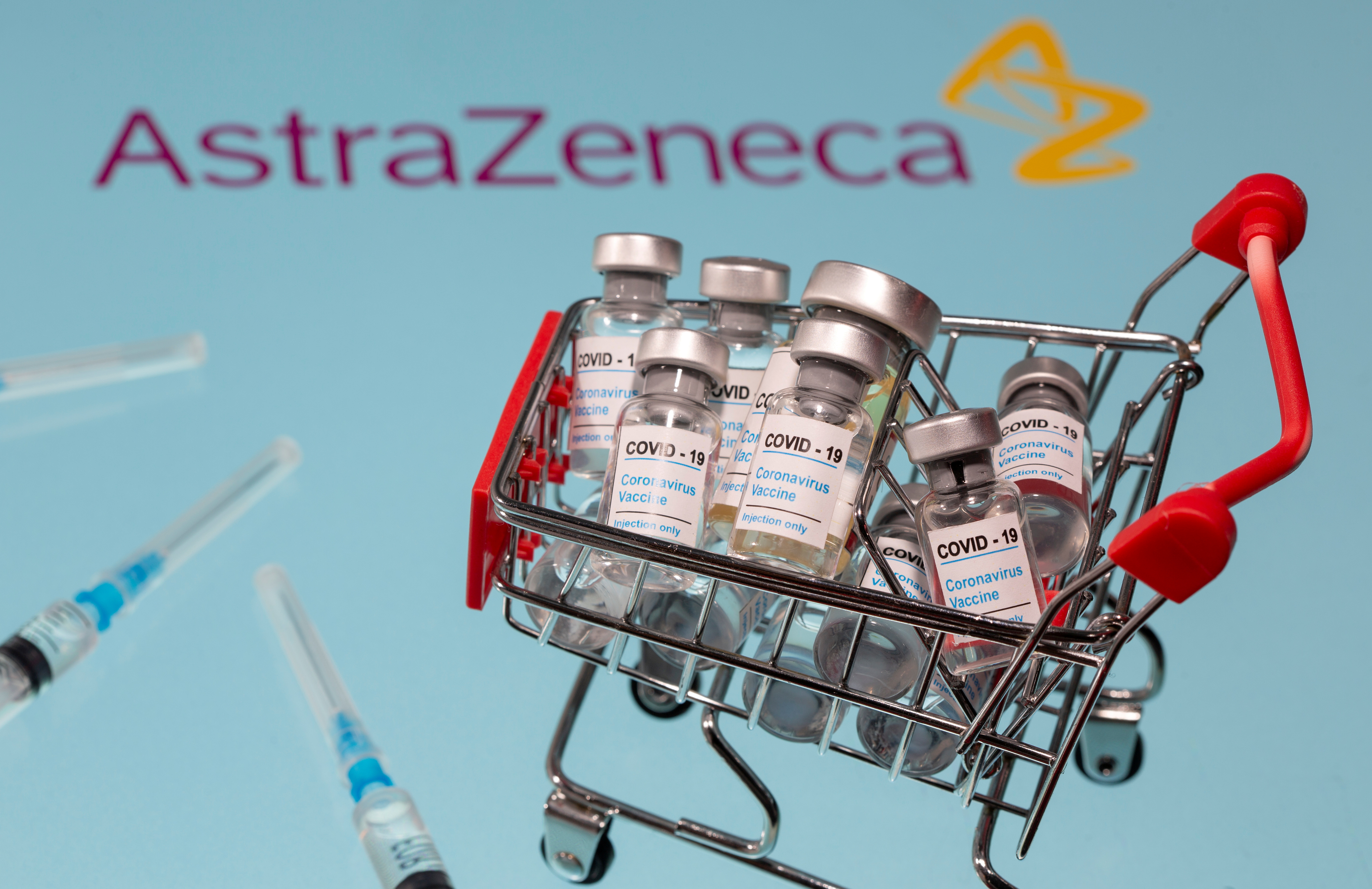 "A small shopping basket filled with vials labeled ""COVID-19 - Coronavirus Vaccine"" and medical syringes are placed on an  AstraZeneca logo in this illustration taken November 29, 2020. REUTERS/Dado Ruvic/Ilustration"