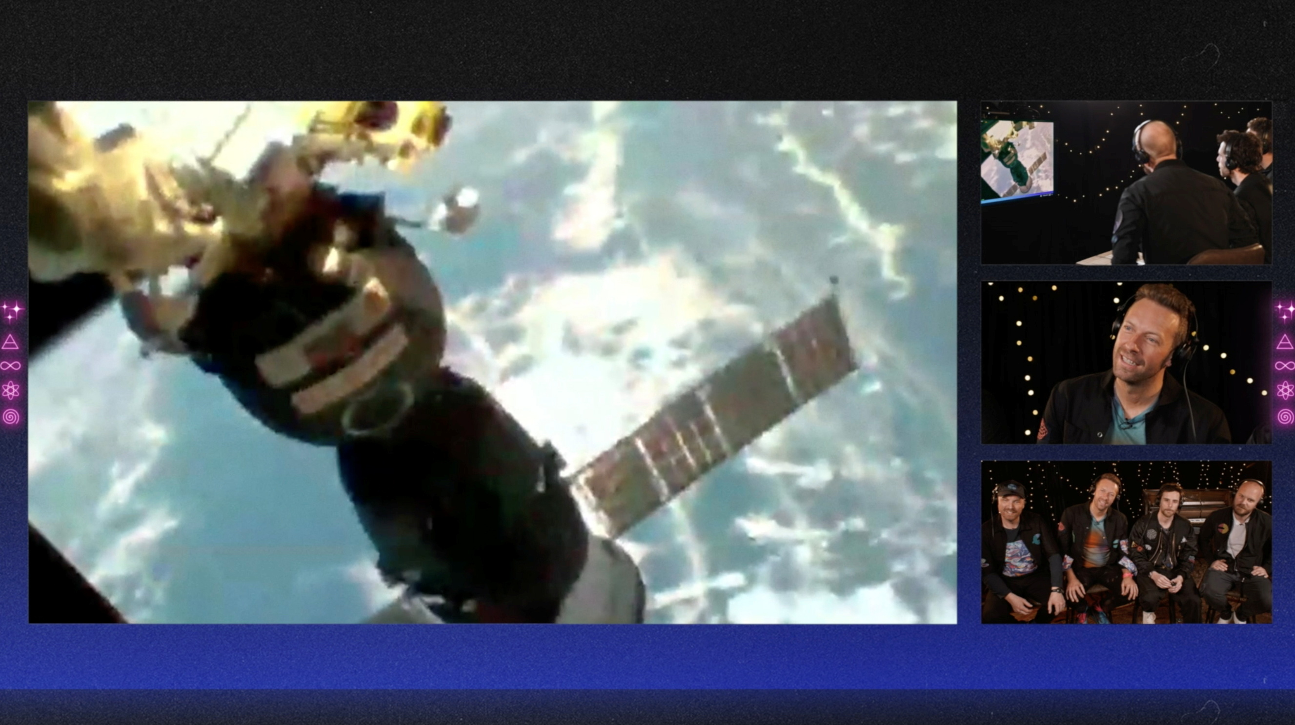 Members of Coldplay watch the view from the window of International Space Station during an interview with French ESA astronaut Thomas Pesquet (not pictured), in this still image from an undated handout video obtained by REUTERS on May 6, 2021. Coldplay/Handout via REUTERS