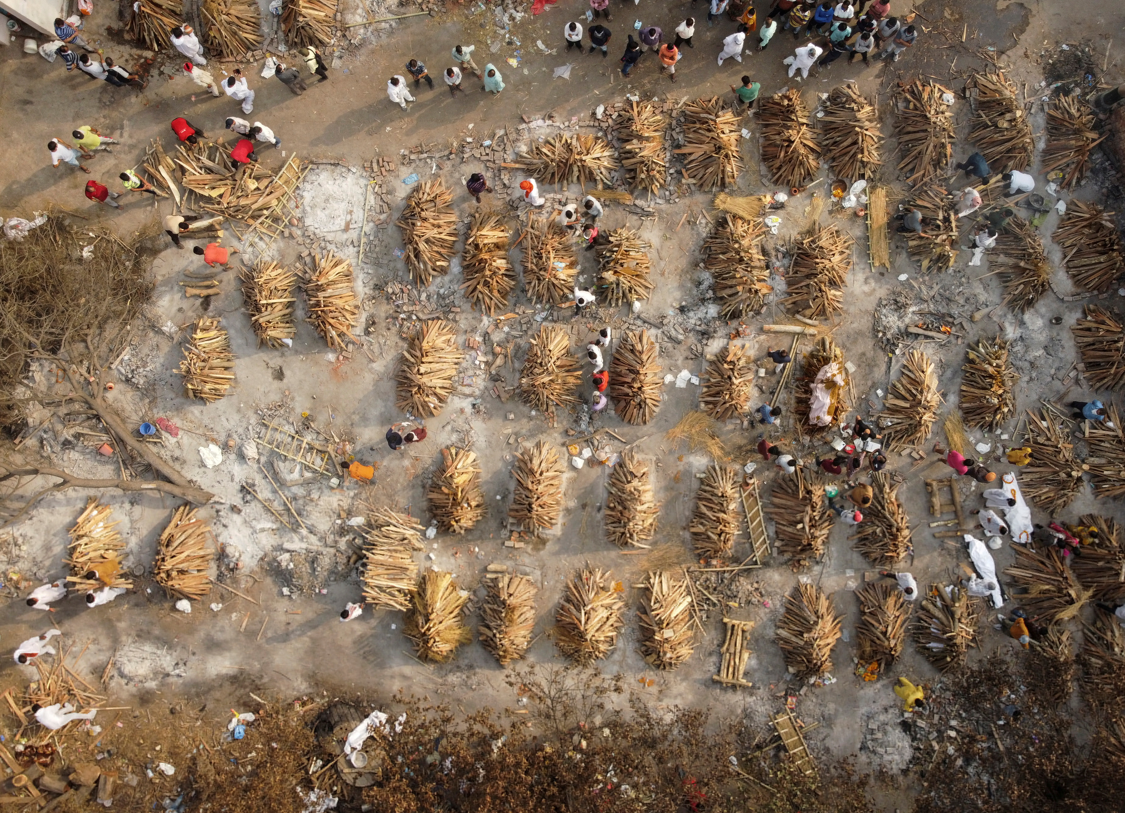 The grounds are prepared for mass cremation of coronavirus disease (COVID-19) victims in New Delhi, India, April 28, 2021. Picture taken with a drone. REUTERS/Danish Siddiqui