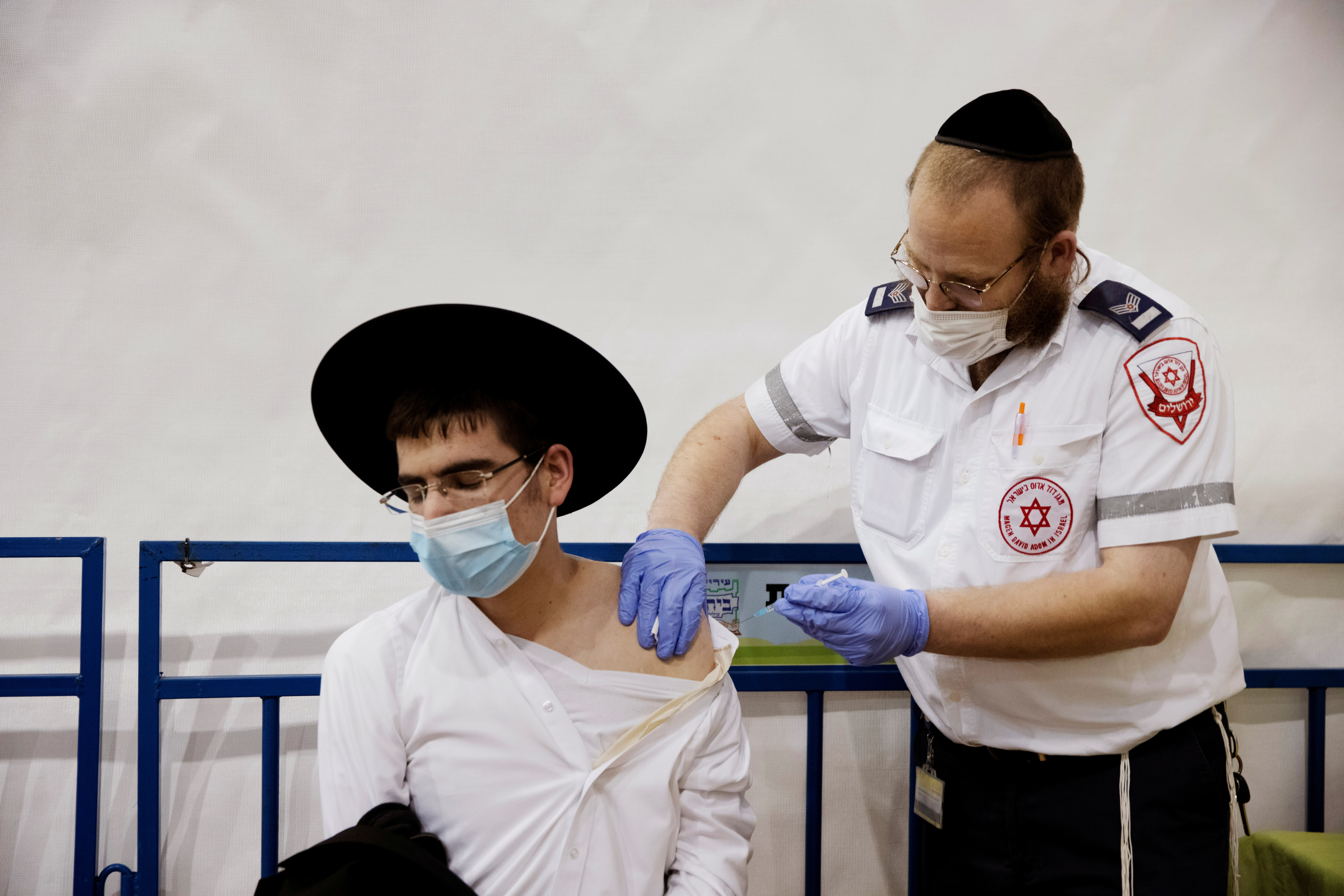 An ultra-Orthodox Jewish man receives a vaccination against the coronavirus disease (COVID-19) at a temporary vaccination centre in the Jewish settlement of Beitar Illit, in the Israeli-occupied West Bank February 16, 2021. REUTERS/Ronen Zvulun