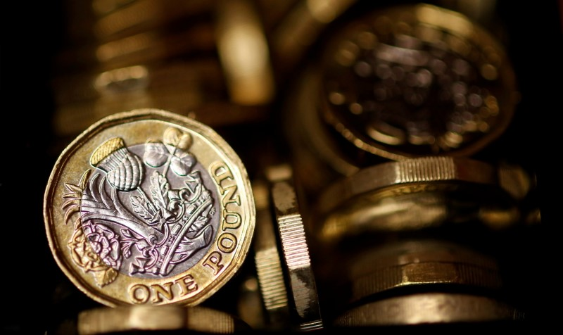 Pound coins are seen in this photo illustration taken in Manchester, Britain September 6, 2017. REUTERS/Phil Noble