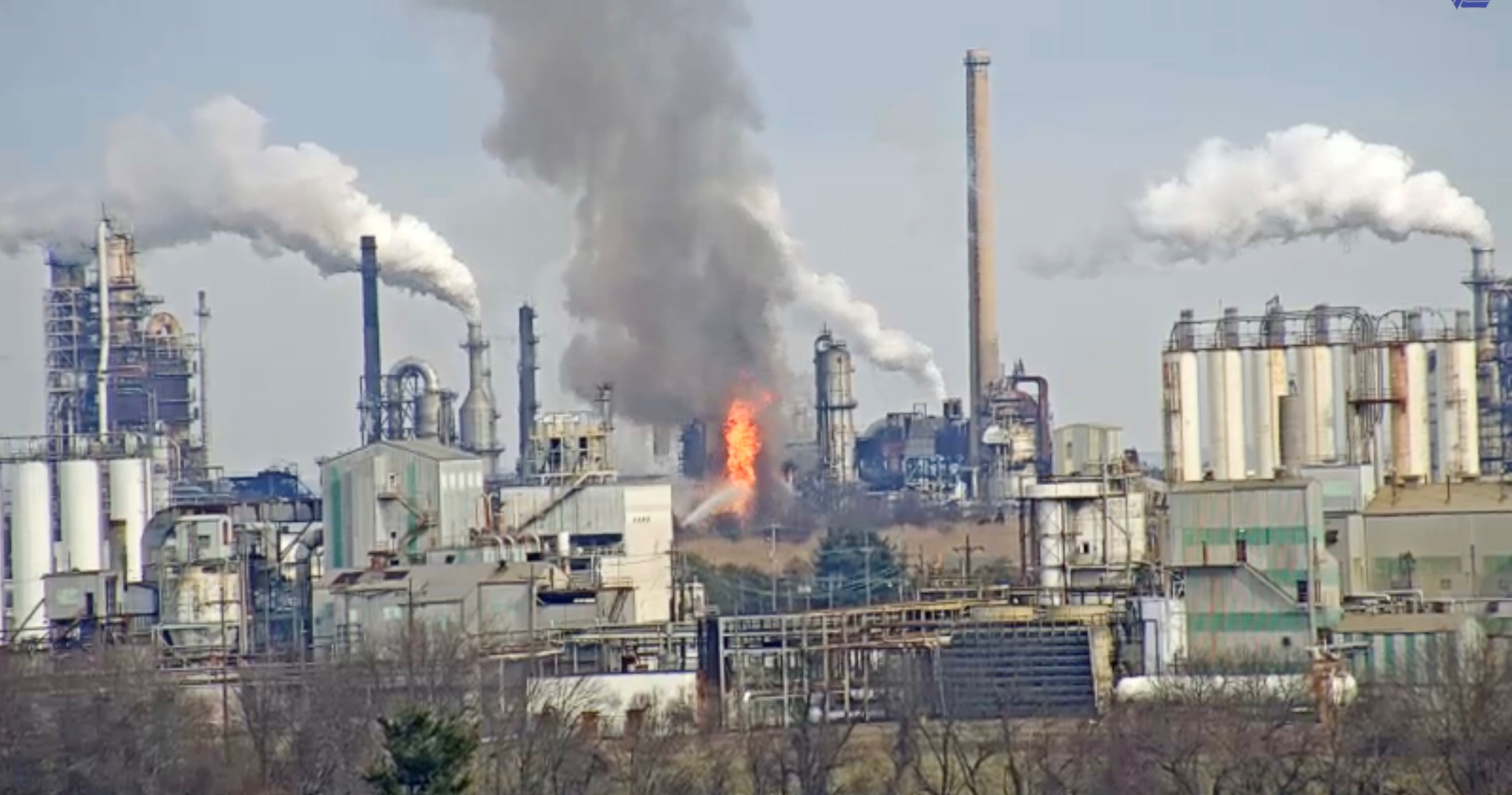 Fire crews battle flames at PBF Energy Inc's 175,000 barrel-per-day crude unit at its Delaware City, Delaware refinery in this still image taken from Delaware Department of Transportation traffic camera video in Delaware City, Delaware, U.S. February 3, 2019.   Delaware DOT/Handout via REUTERS