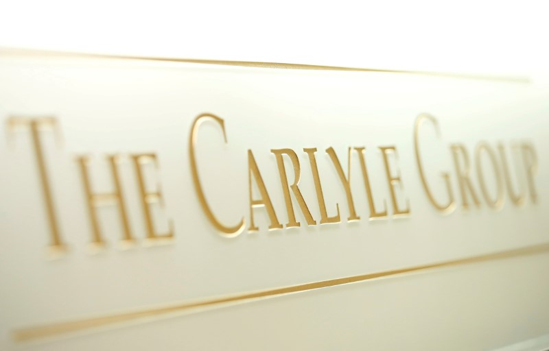 The logo of the Carlyle Group is displayed at the company's office in Tokyo, Japan October 17, 2018. REUTERS/Issei Kato/File Photo