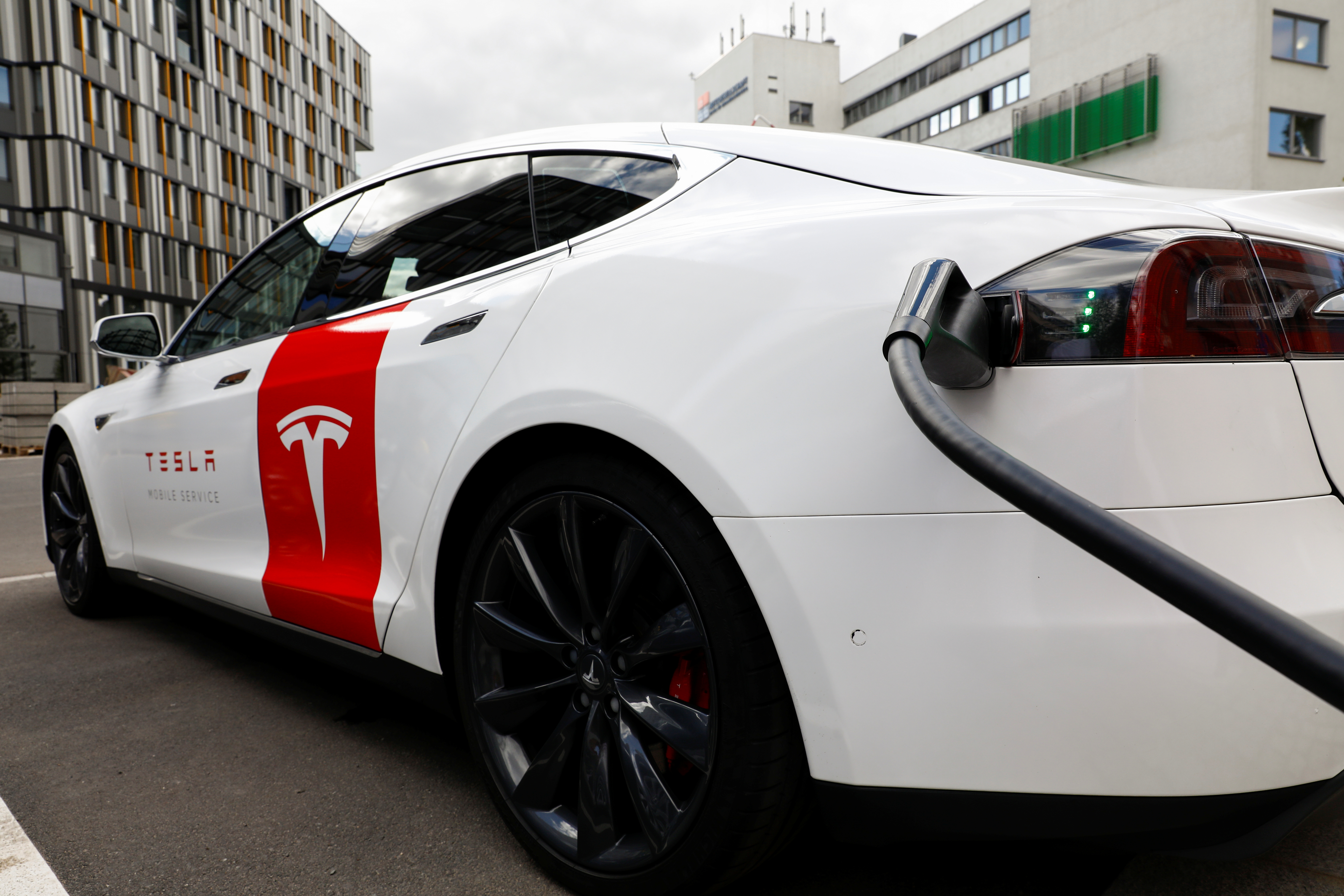 A Tesla car is seen at the V3 supercharger equipment during the presentation of the new charge system in the EUREF campus in Berlin, Germany September 10, 2020. REUTERS/Michele Tantussi