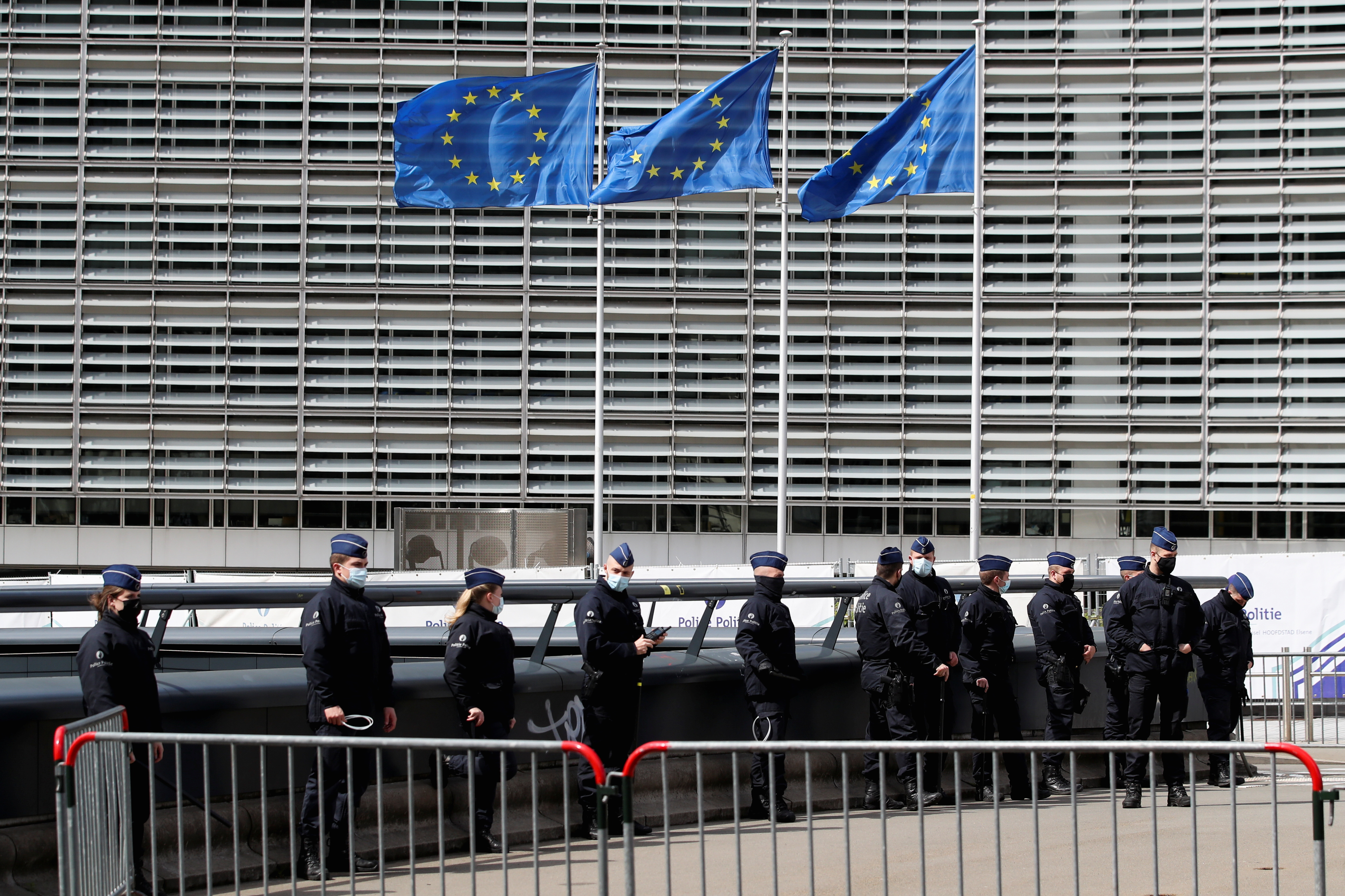 Police officers secure the area around the EU Commission where the EU summit is taking place in Brussels, Belgium, May 24, 2021. REUTERS/Yves Herman